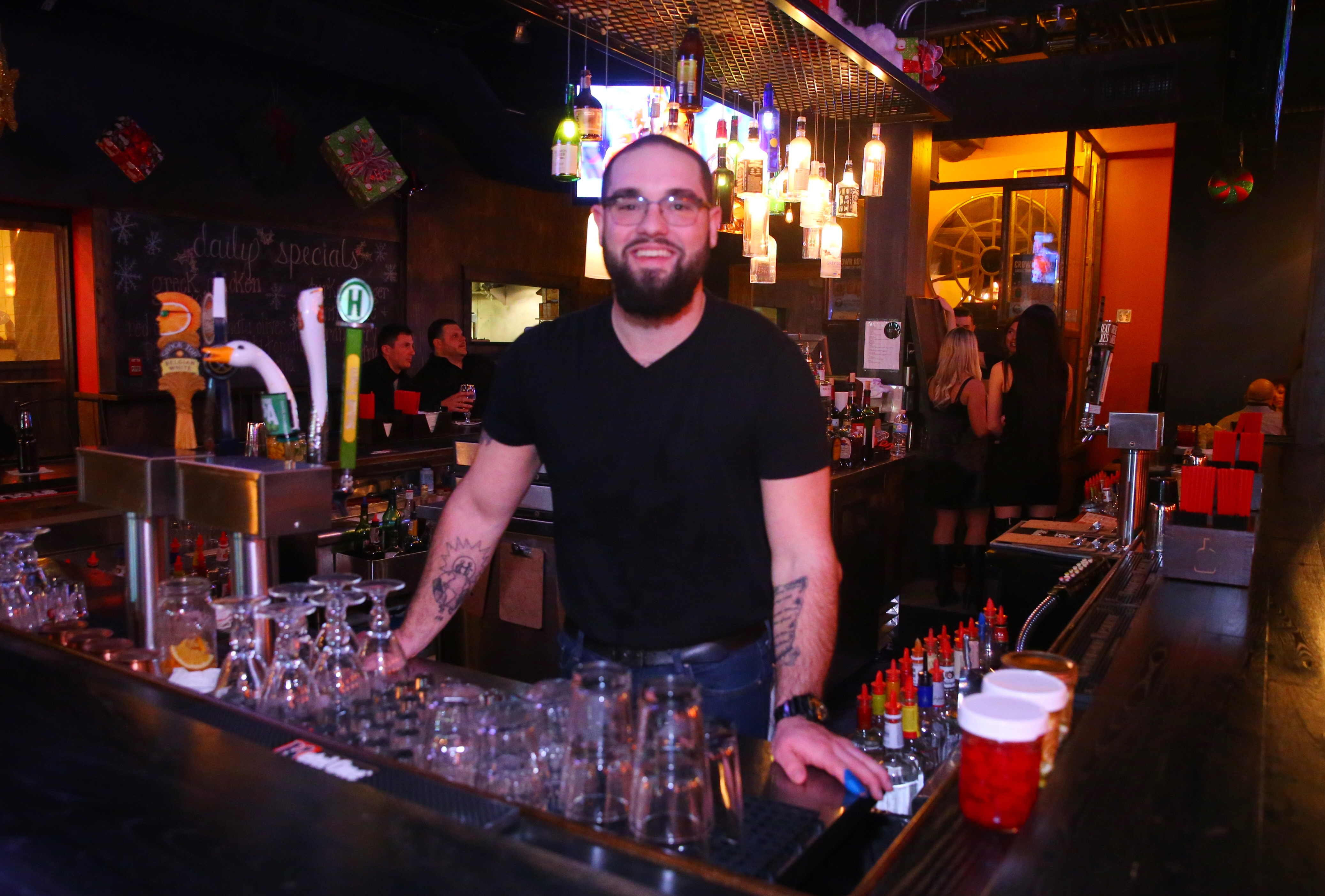 Ben Pulkudnik, a bar-back  at  SOHO, said his resolution is to be more positive in 2017.  (John Hickey/Buffalo News)