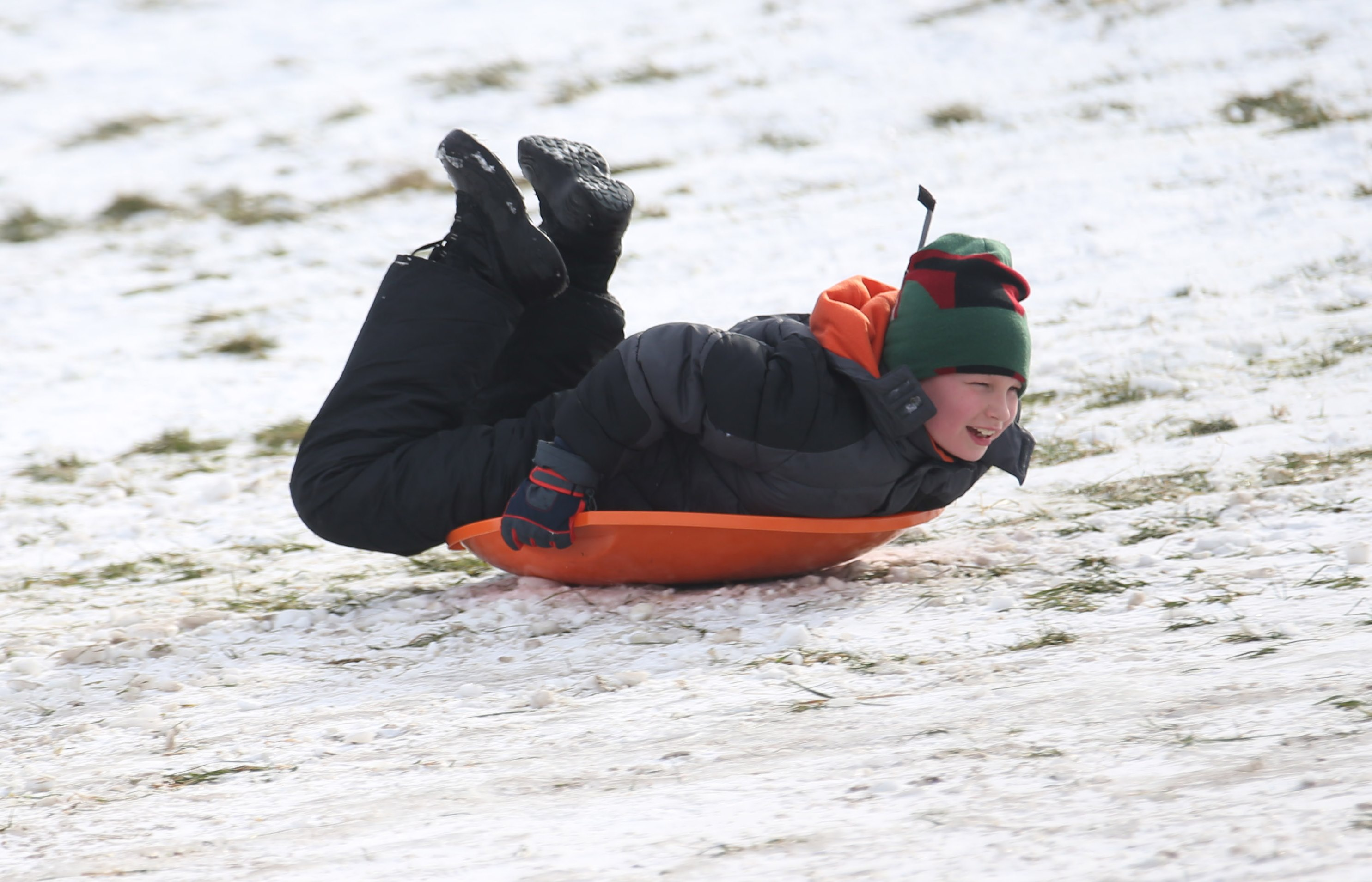 Connor Mattheus, 8, of Amherst, goes down the Saratoga Hill in Amherst in his saucer. (Sharon Cantillon/Buffalo News)