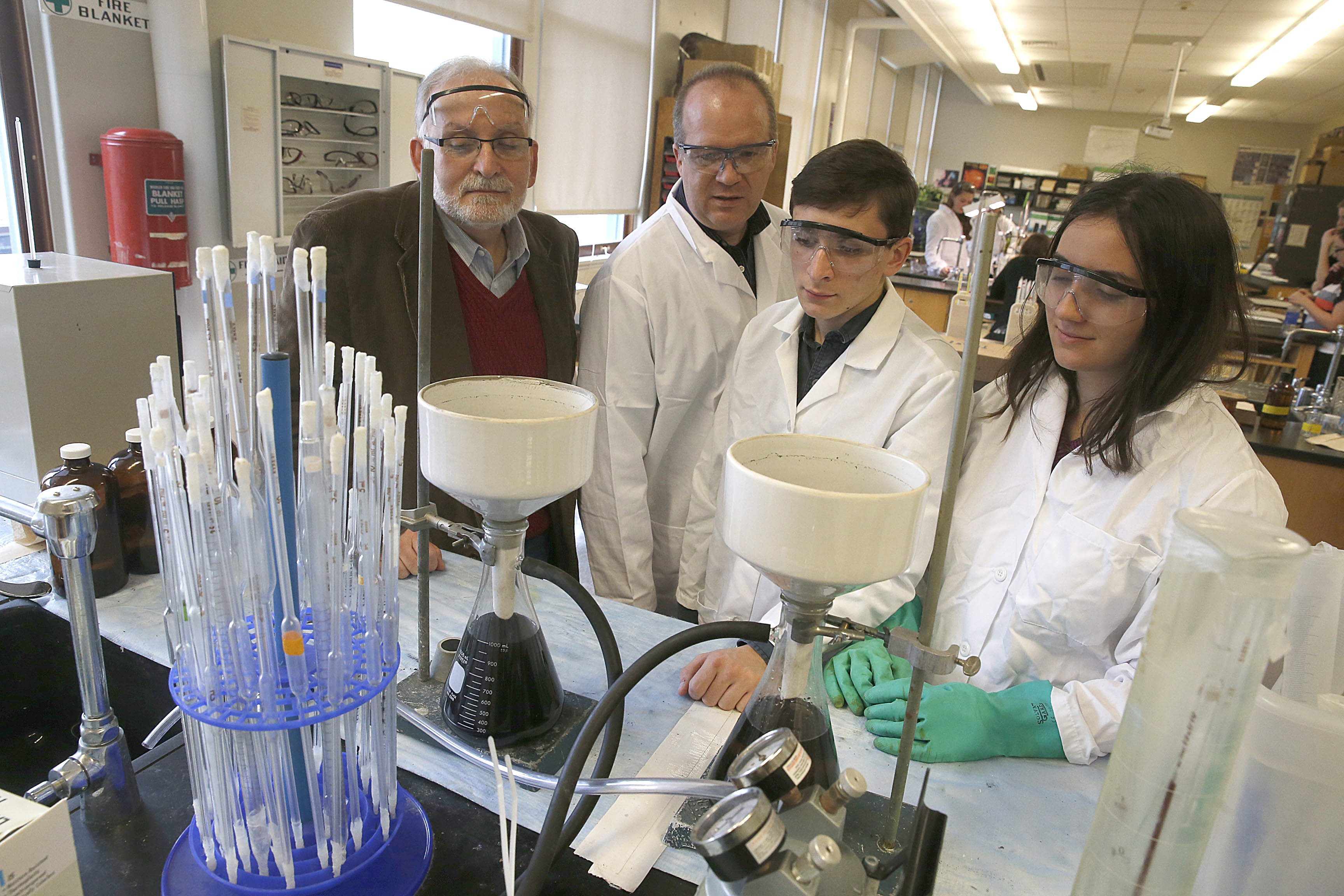 From left, UB Professor Joseph Gardella, who has spearheaded the Interdisciplinary Science and Engineering Partnership chemistry teacher Daniel Hildreth, and students Ryne McCarthy and Maggie Zaifer examine the progress of a Graphene Oxide experiment at South Park High School last December. (Robert Kirkham/Buffalo News)