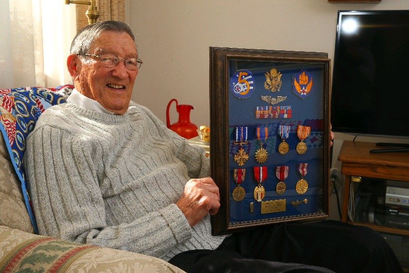 WWII Army Air Force pilot Jim Cherkauer earned a host of medals, including the Distinguished Flying Cross  for bringing his  damaged B-24 bomber home after being hit with anti-aircraft fire. (John Hickey/Buffalo News)