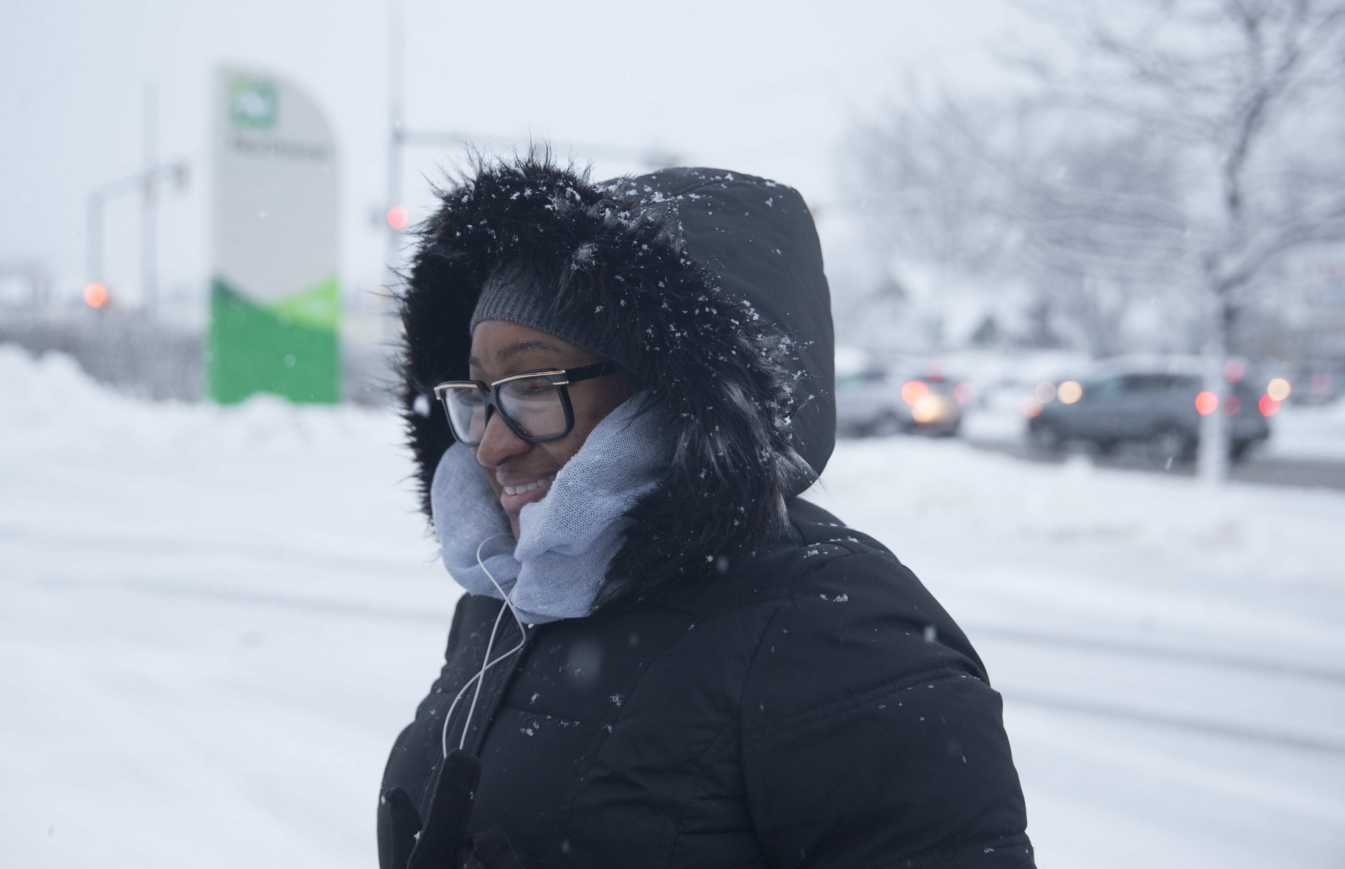 Sheena Davis is all bundled up as she walks to work off  Kenmore and Starin avenues on Thursday. (John Hickey/Buffalo News)