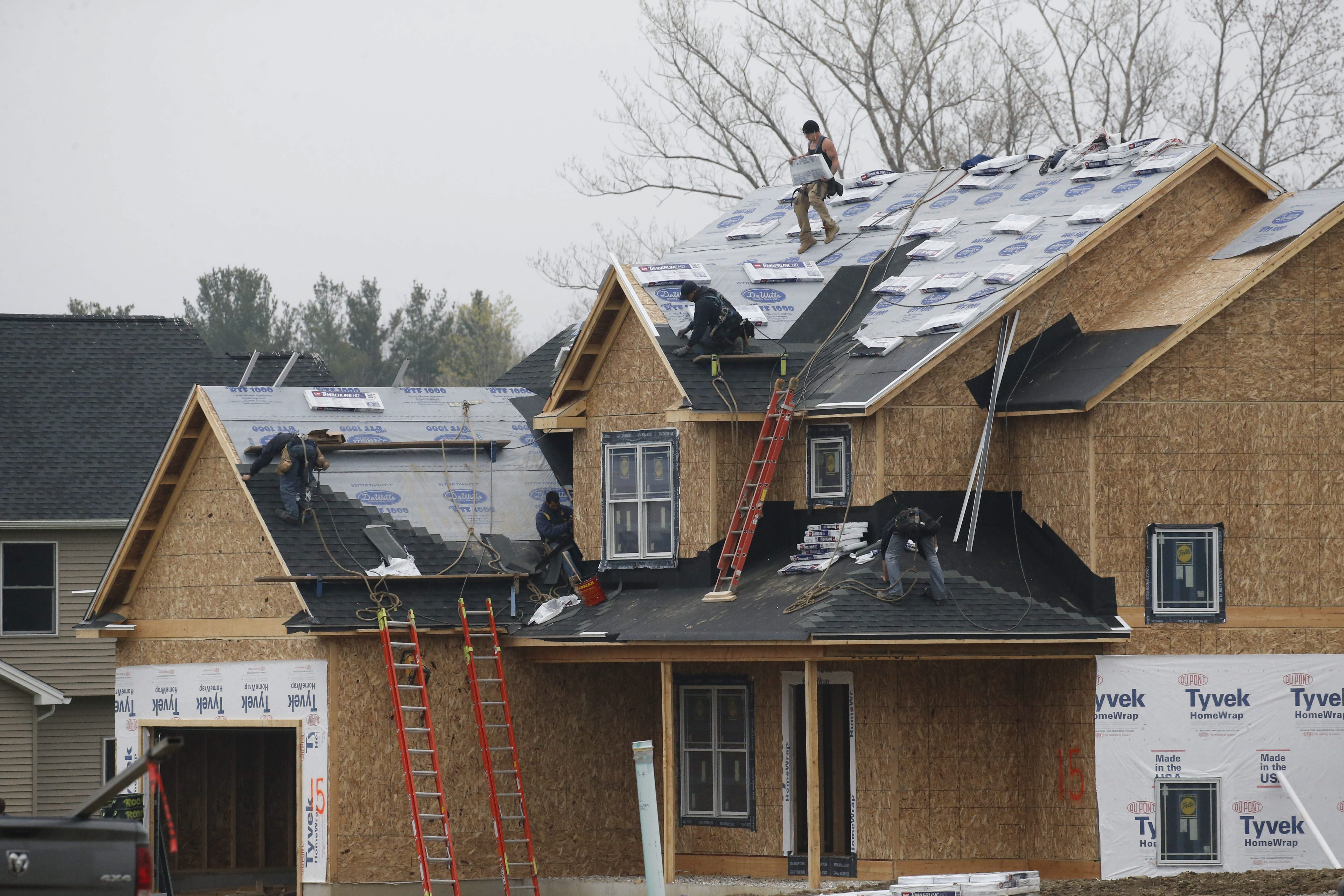 Roofers work on a new build in a new subdivision on Golden Oak Lane in Orchard Park, Thursday, May 5, 2016.  (Derek Gee/Buffalo News)