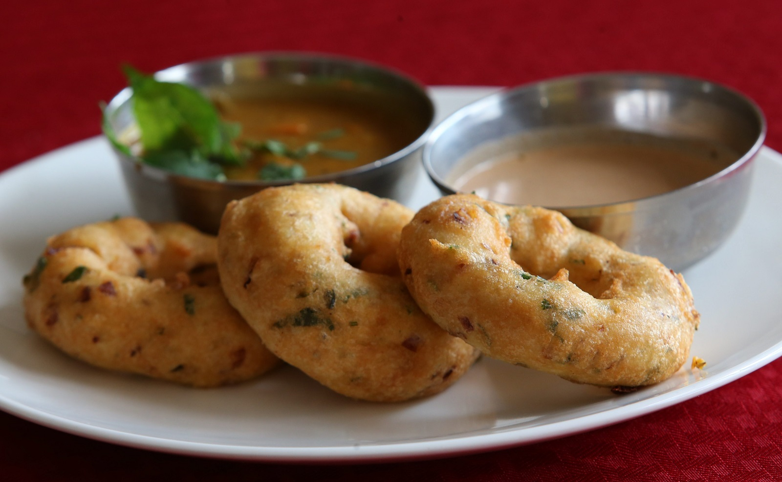 Hyderabad Biryani House's vada is a savory doughnut, made out of lentil batter and served with fresh coconut chutney and sambar. (Sharon Cantillon/Buffalo News)
