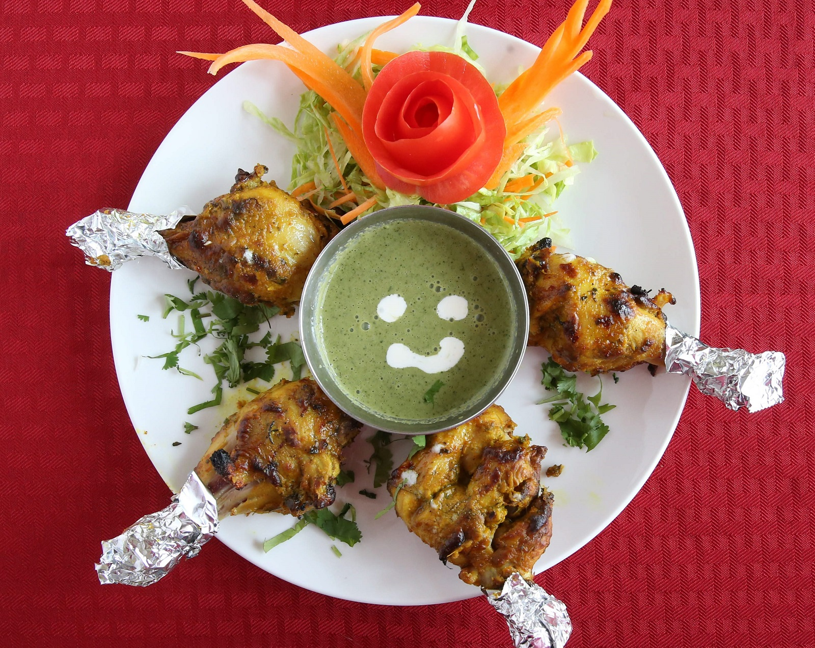 Hyderabad Biryani House's Thangdi Kabab is made with four chicken drumsticks, marinated in yogurt, garlic, ginger and fresh ground spices. (Sharon Cantillon/Buffalo News)
