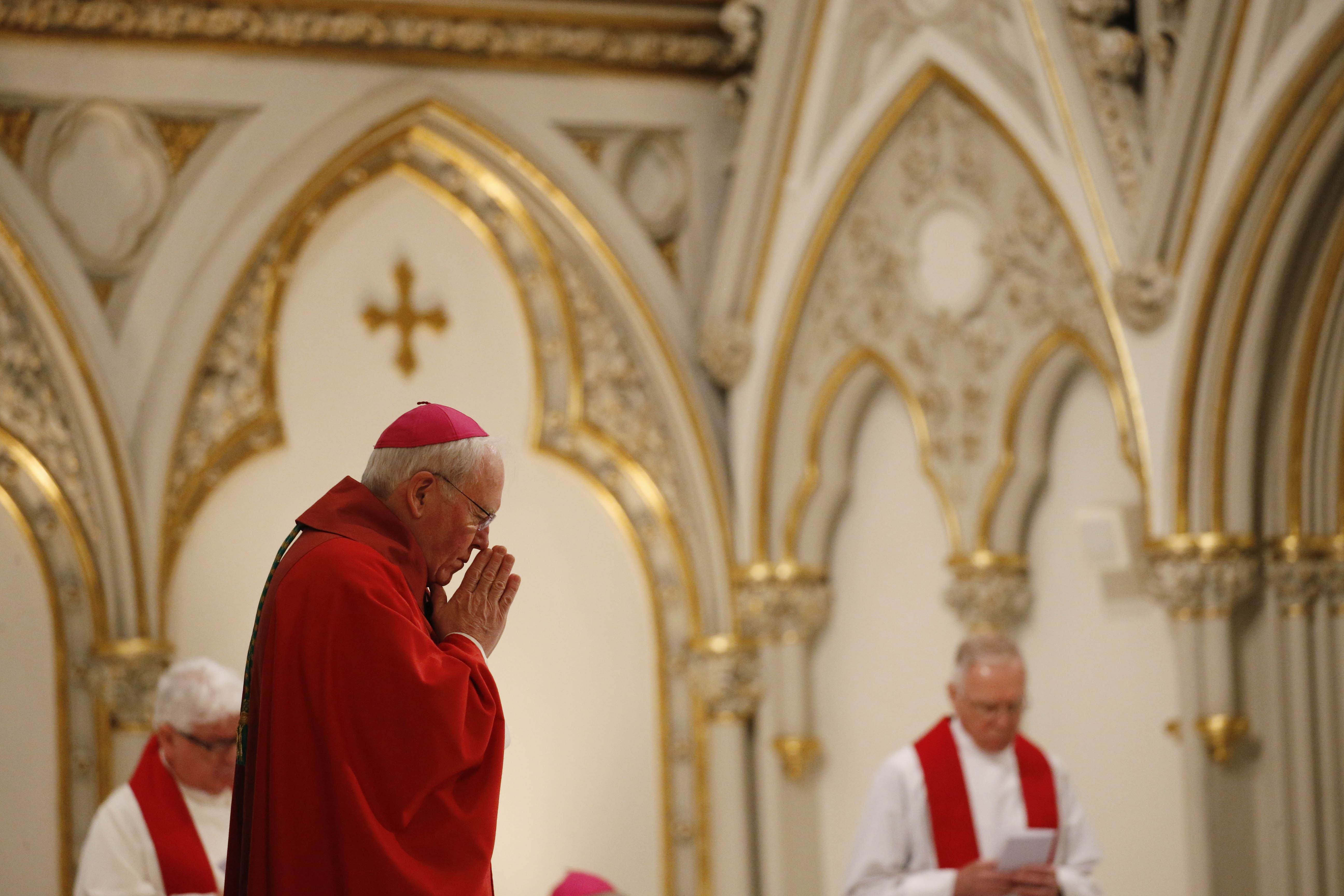 Bishop Richard Malone presides over the Solemn Celebration of the Lord's Passion at St. Joseph Cathedral on Good Friday, March 25, 2016.  (Derek Gee/Buffalo News)