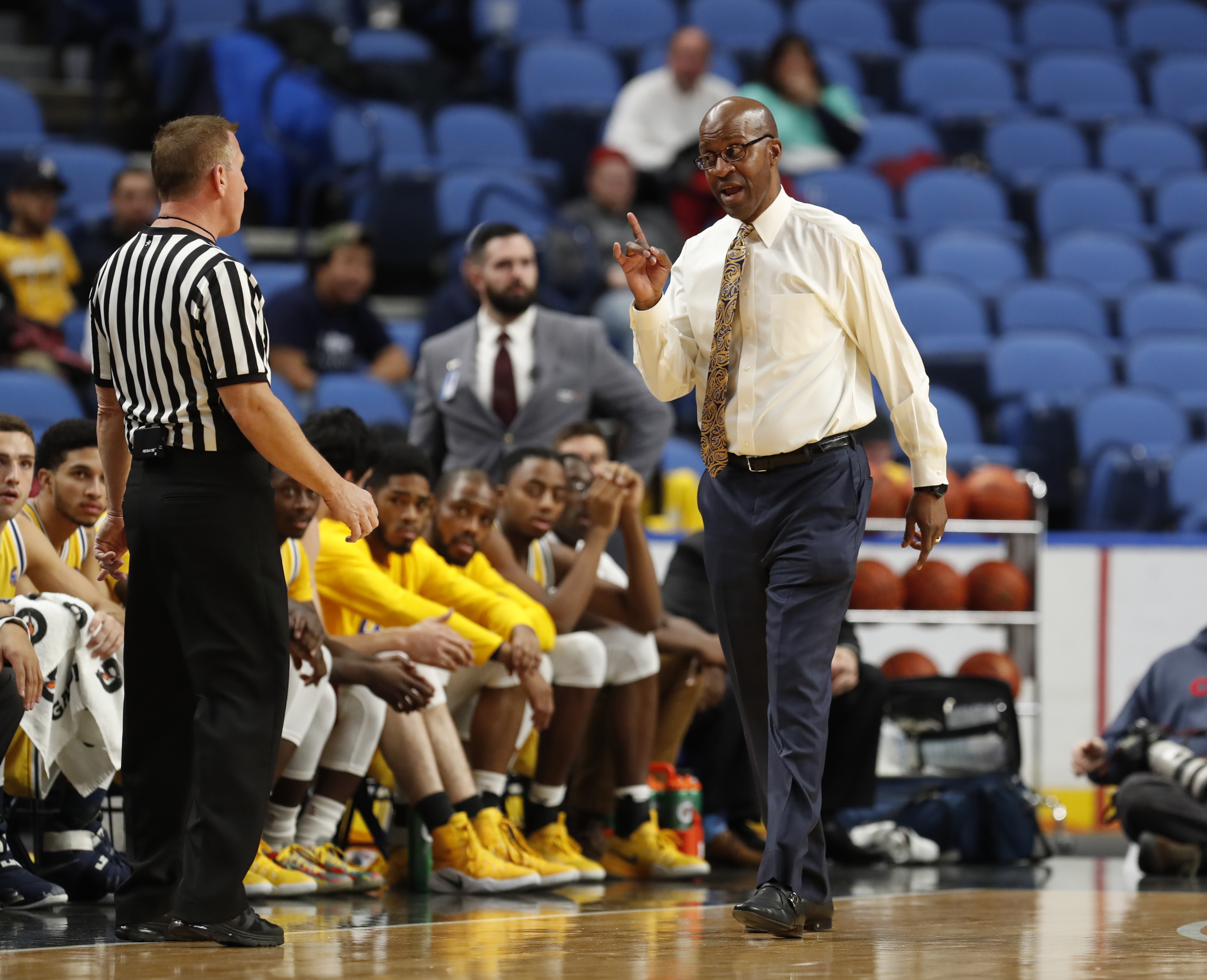 Canisius coach Reggie Witherspoon has a spirited conversation with an official against the  University at Buffalo during first half action at the Big 4 classic at the Key Bank Center on Saturday, Dec. 17, 2016. (Harry Scull Jr./Buffalo News)