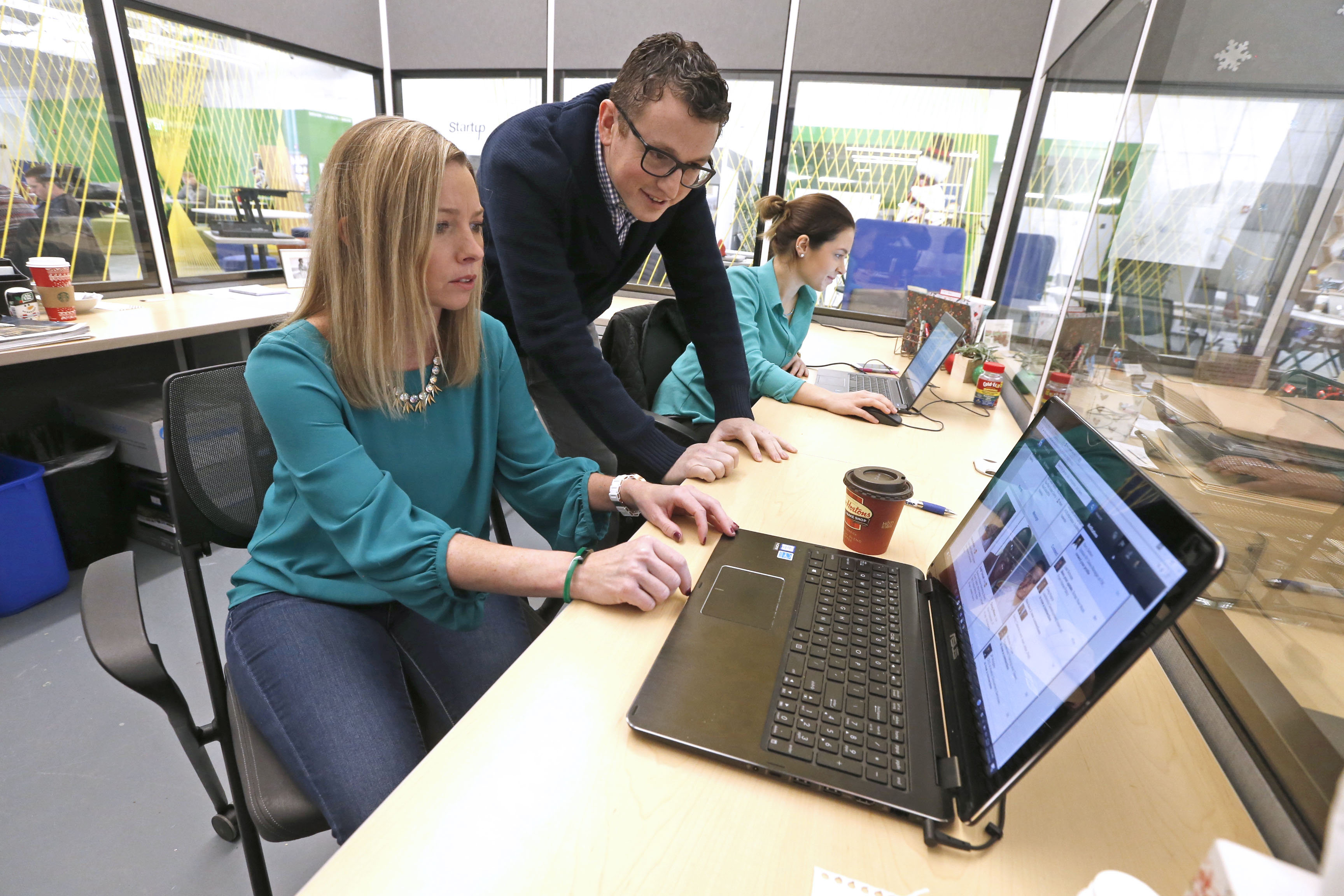 Joel Shapiro, president of JMS Technical Solutions in Buffalo, is constantly searching for qualified candidates at his staffing business. Flanking him are Jennifer Mazurkiewicz, left, director of business development, and Chelsea Robinson, a recruiter. (Robert Kirkham/Buffalo News)