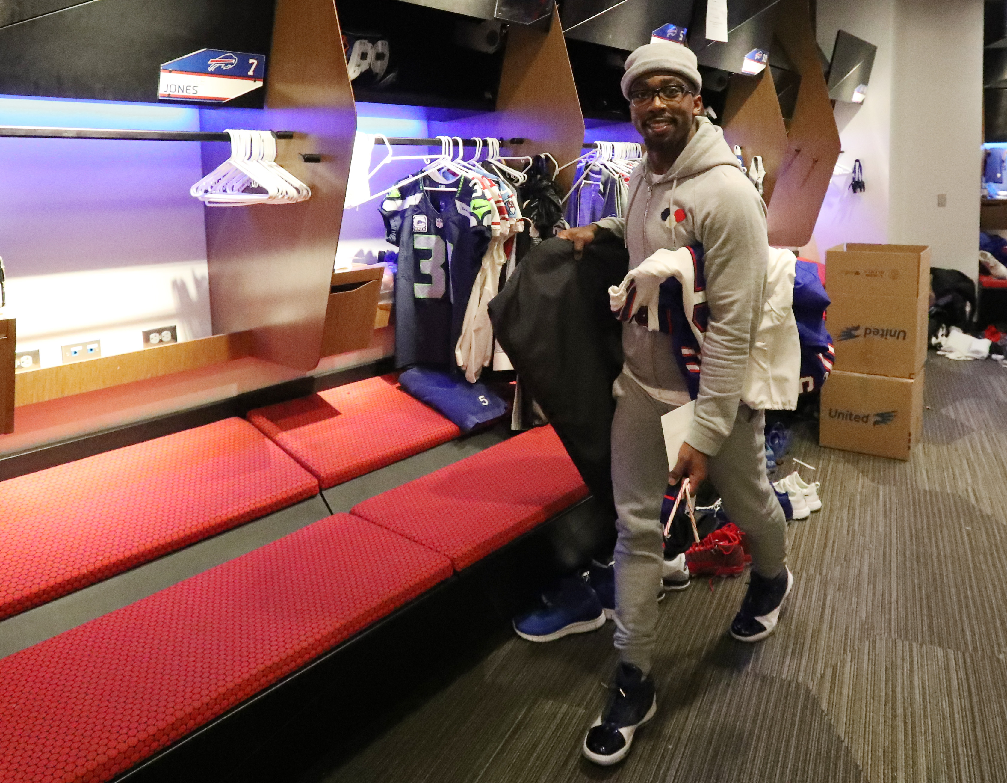 Buffalo Bills quarterback Tyrod Taylor carries some of his equipment during locker clean out at ADPRO Sports Training Center in January. (James P. McCoy/Buffalo News)