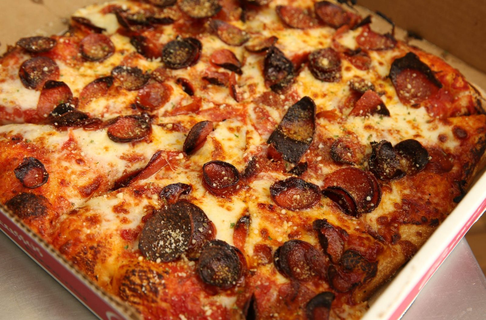 """At Picasso's, pepperoni is cut on a bias and chars up into """"cups"""" on the pizza. Picasso's has four area locations, including 2193 Union Road in West Seneca where this photo was taken.  (Sharon Cantillon/Buffalo News)"""
