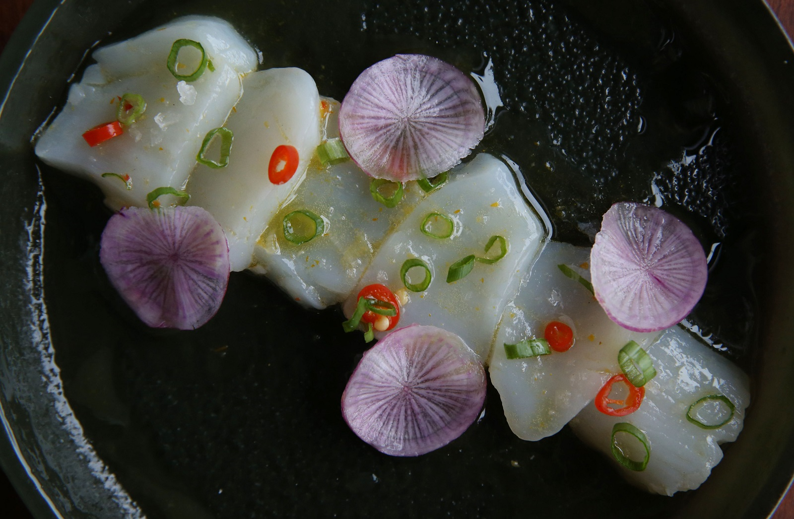 The Dapper Goose, which prepared this scallop crudo, is among first-time participants in Dining OUt for Life 2017. (Sharon Cantillon/Buffalo News)