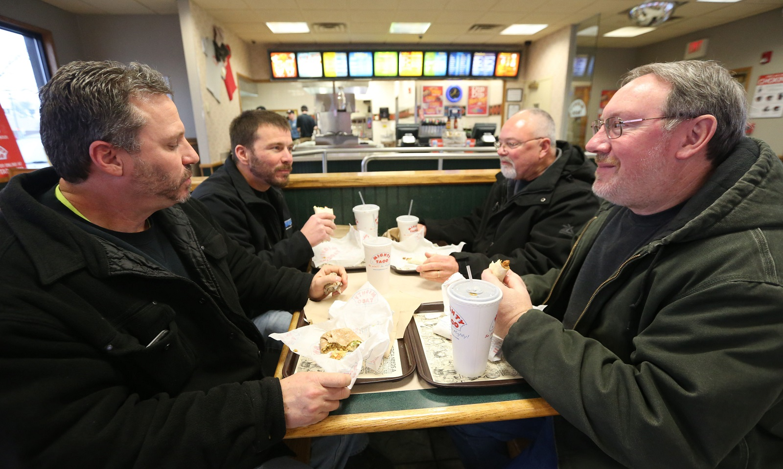 Co-workers have lunch together at the Sheridan Drive Mighty Taco. From left are Chris Gates, Pete Gruenthaner, Kevin Dougherty and Glen Webster.  (Sharon Cantillon/Buffalo News)