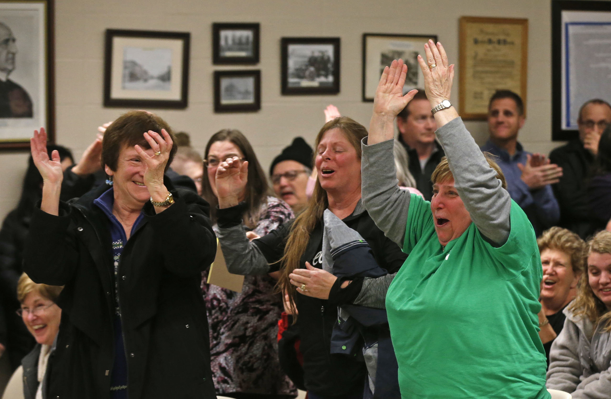 Depew residents at Village Hall Tuesday night celebrate the news that a dissolution referendum was resoundingly defeated.  (Robert Kirkham/Buffalo News)