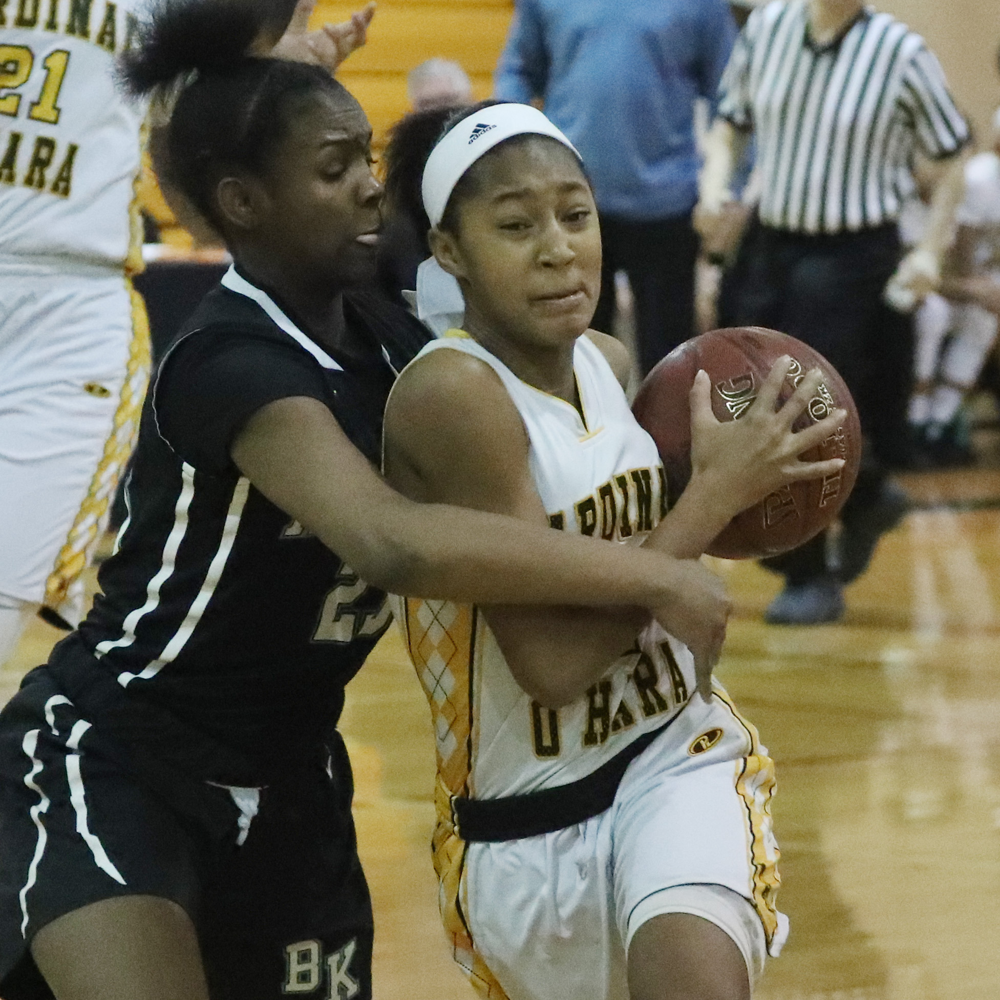 O'Hara's Angel Parker is fouled by Bishop Kearney's Allure Simmons in the second quarter at Cardinal O'Hara during the Hawks' victory Wednesday. (James P. McCoy/Buffalo News)