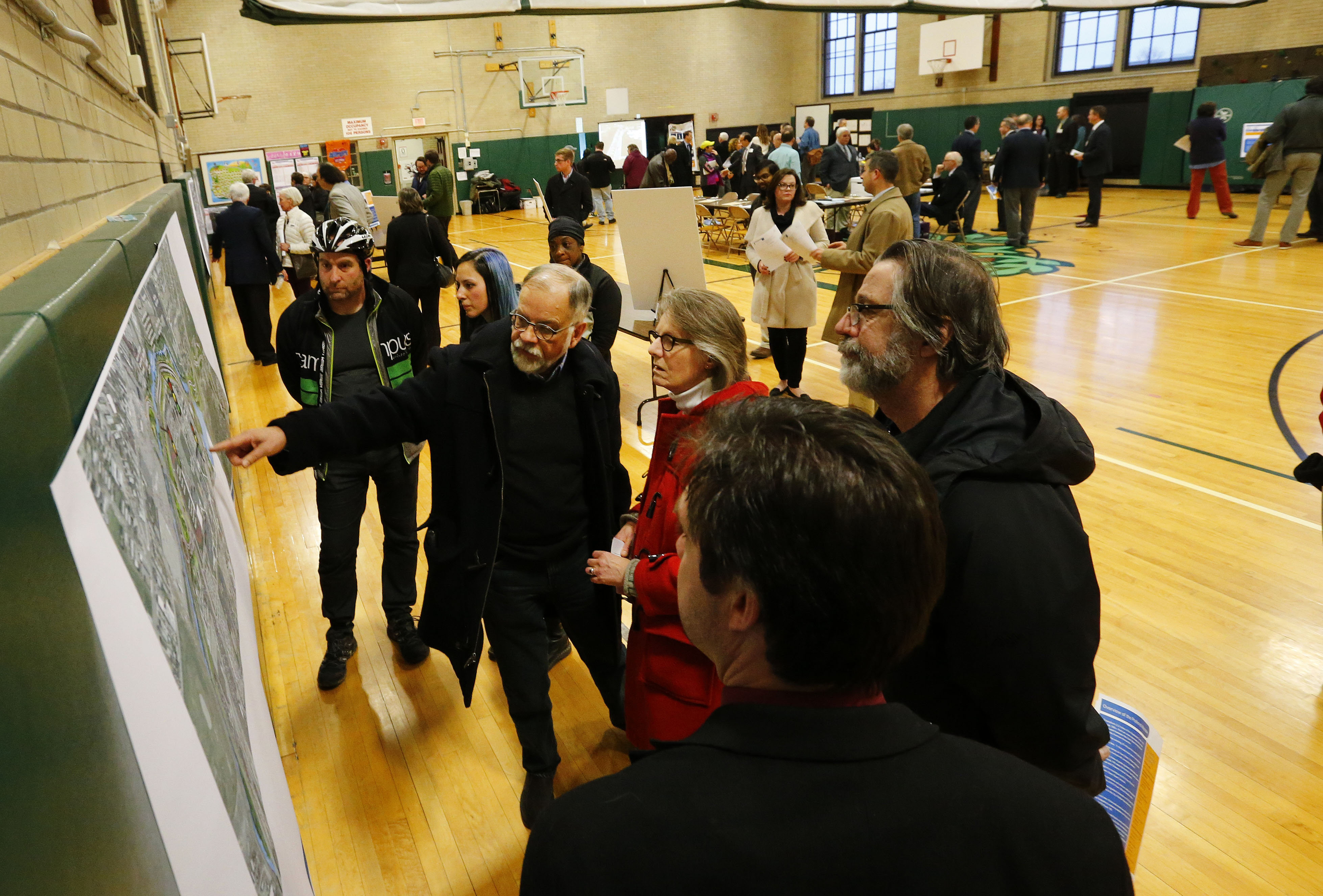 Residents look over the State Department of Transportation's proposals for converting the Scajaquada from a highway to a 30 mile per hour road  before a hearing at the Olmsted school in Buffalo Wednesday, January 25, 2017.  (Mark Mulville/The Buffalo News)