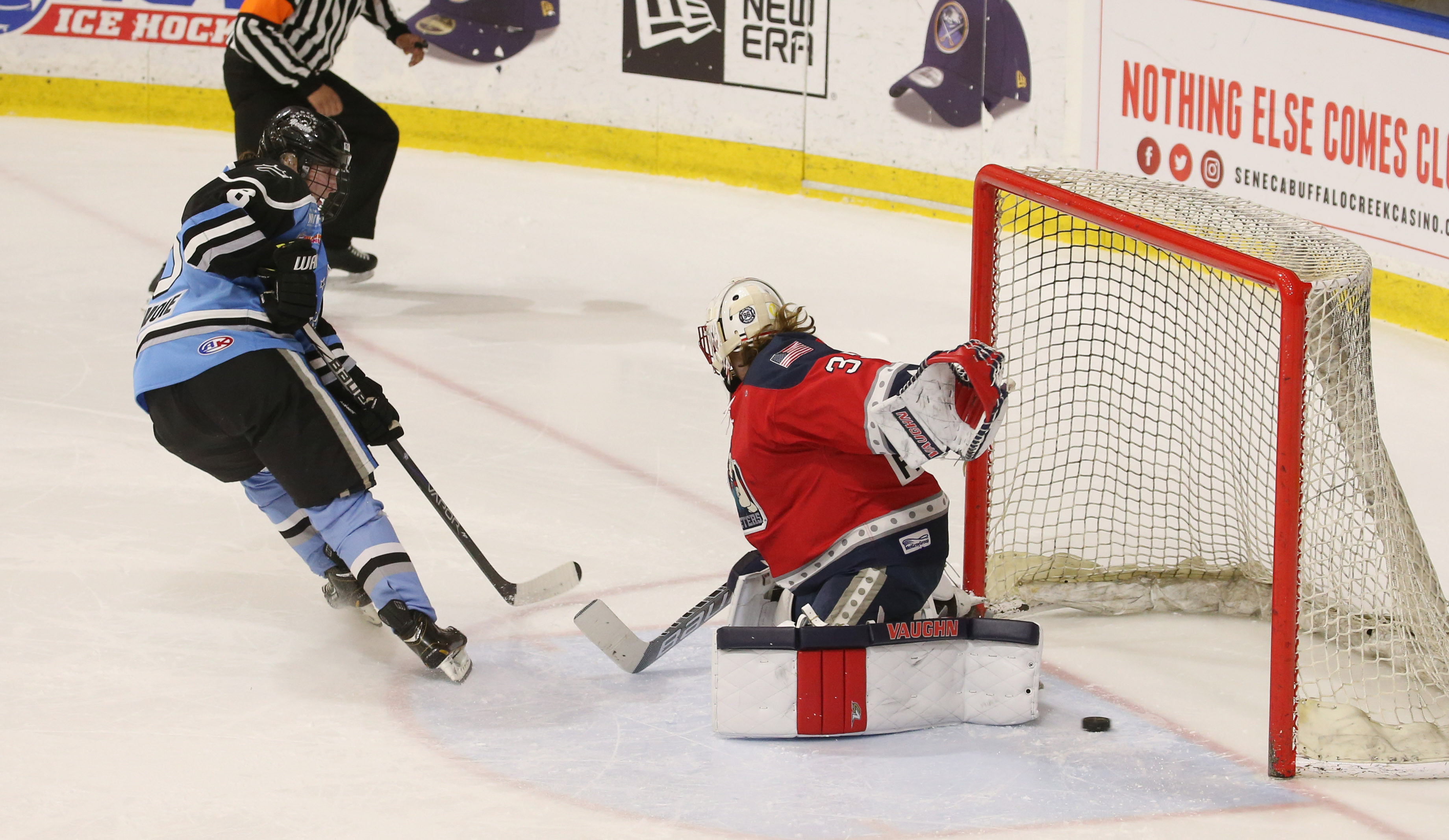 Kristina Lavoie scores the lone shootout goal past Riveters goalie Katie Fitzgerald to give the Beauts a 4-3 win Friday. (Sharon Cantillon/Buffalo News)