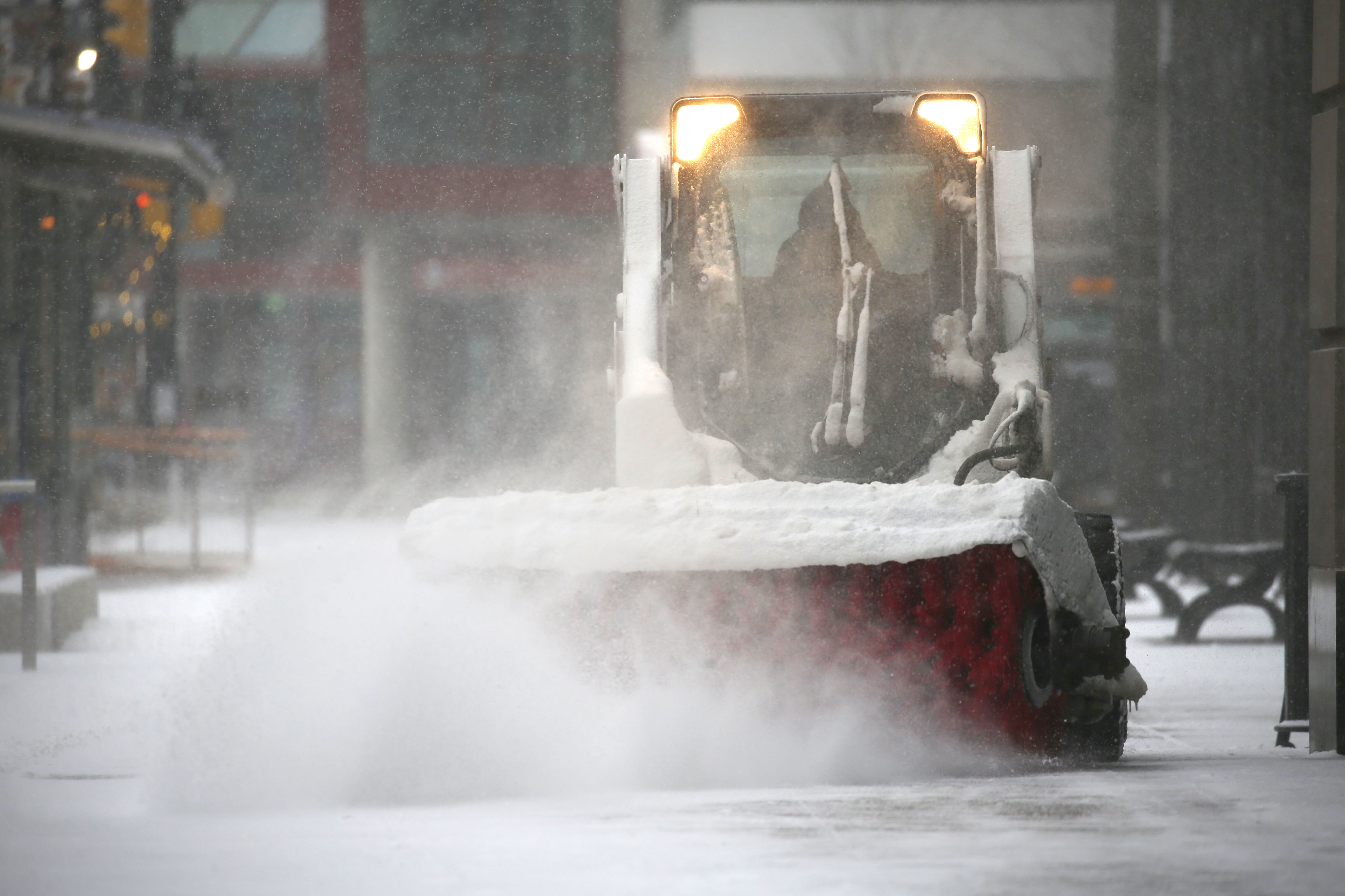 A snow sweeping machine clears a path on the sidewalk on Main St. in downtown Buffalo onSaturday, Jan. 28, 2017.  (Robert Kirkham/Buffalo News)