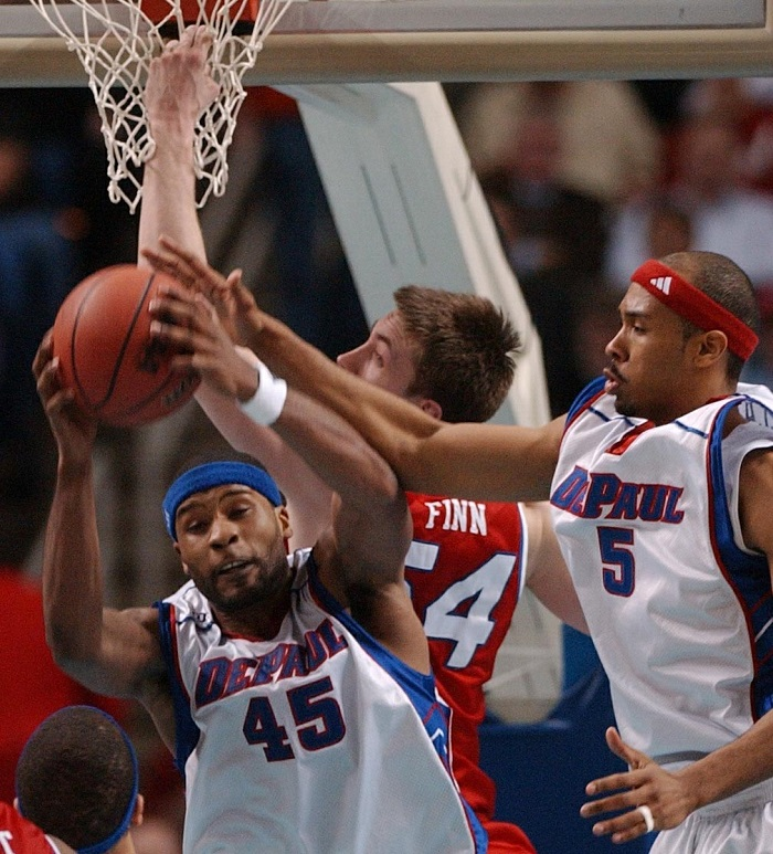 DePaul's Quemont Greer and Delonte Holland battle for a rebound with Dayton's Sean Finn. (Mark Mulville/Buffalo News)