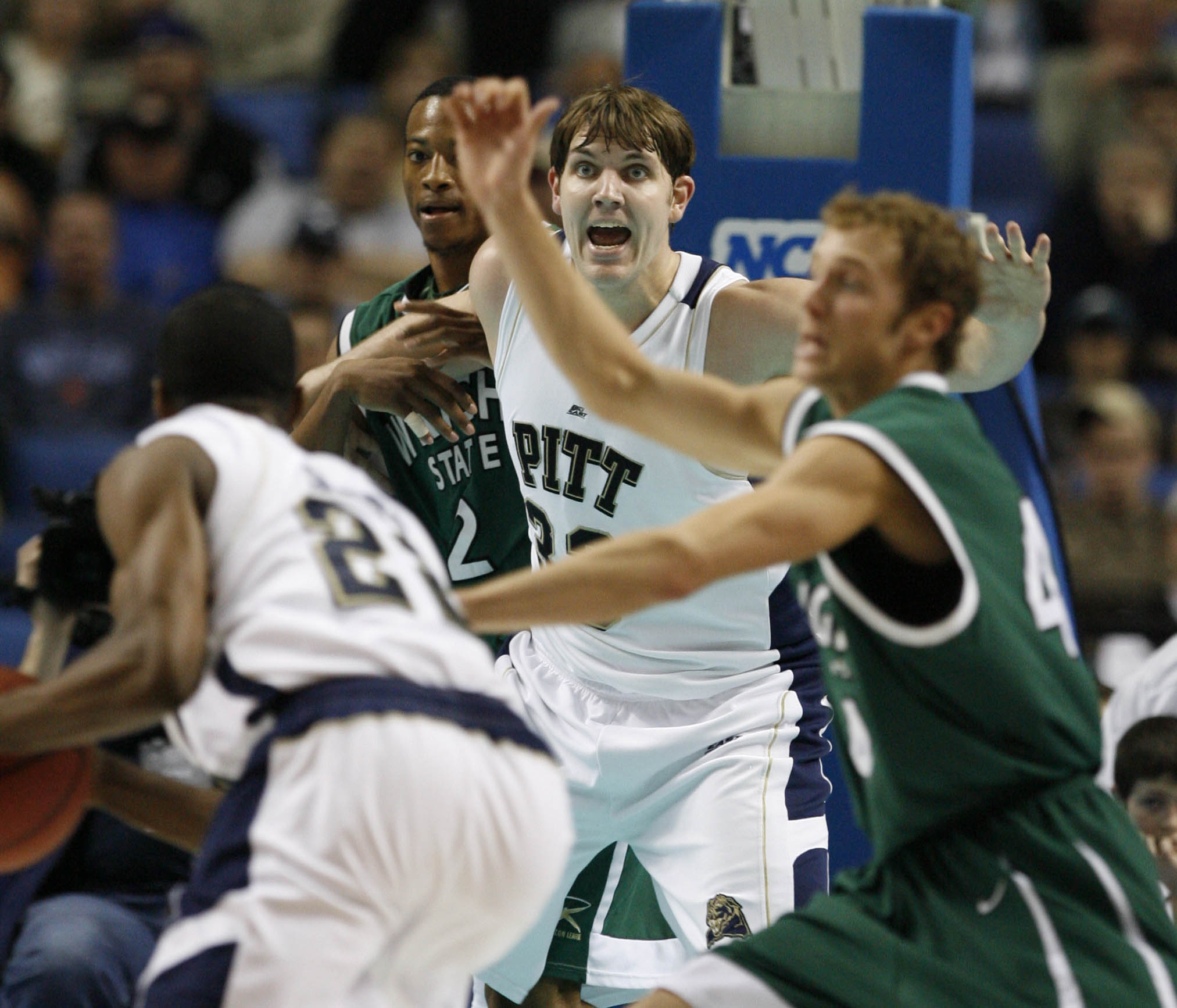 Aaron Gray looks for the pass inside during the first half of their game with Wright State.  (Mark Mulville/Buffalo News)