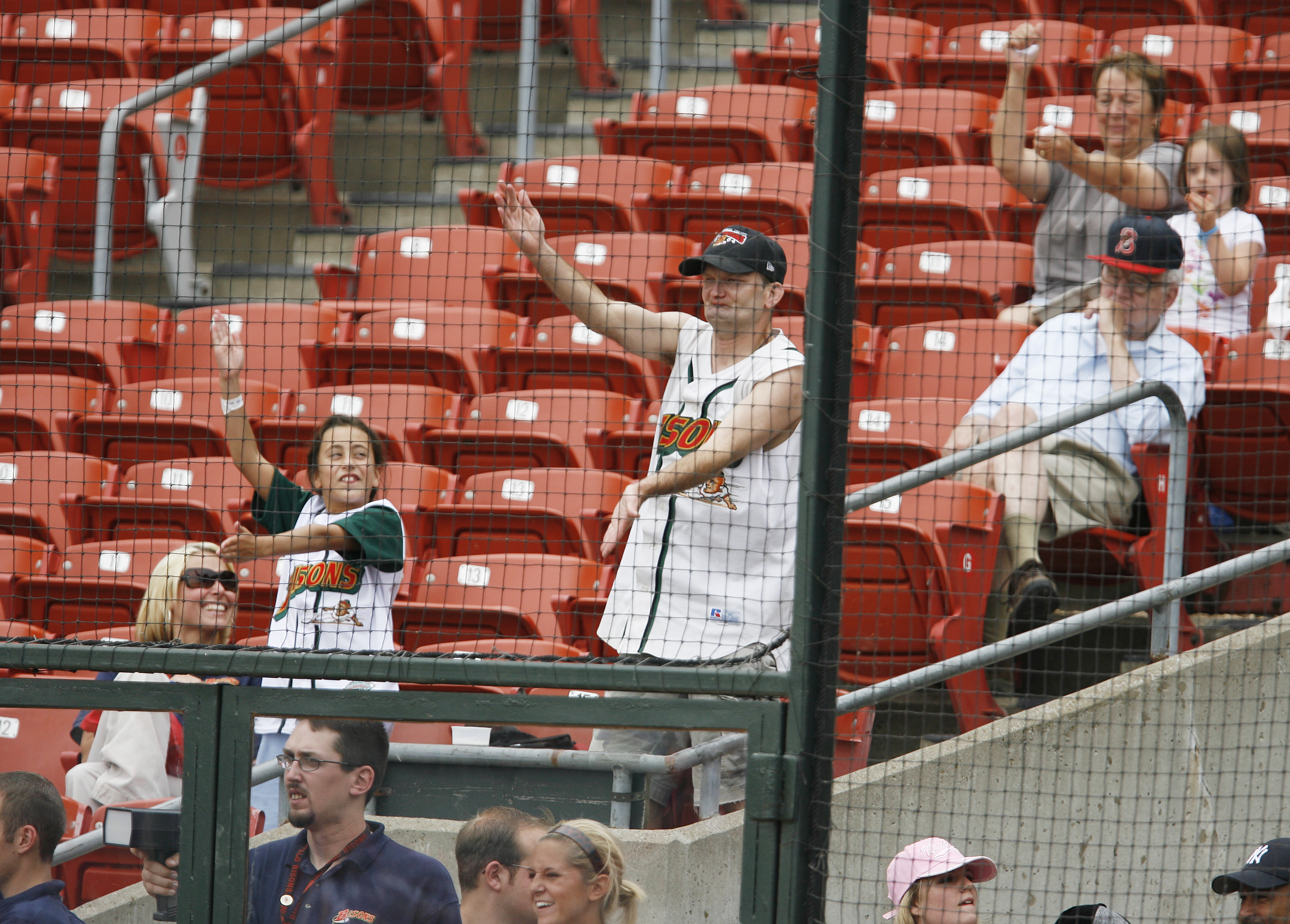 Bisons fans dance behind home plate to the song played when Andy Marte gets up to the plate. (James P. McCoy/Buffalo News)