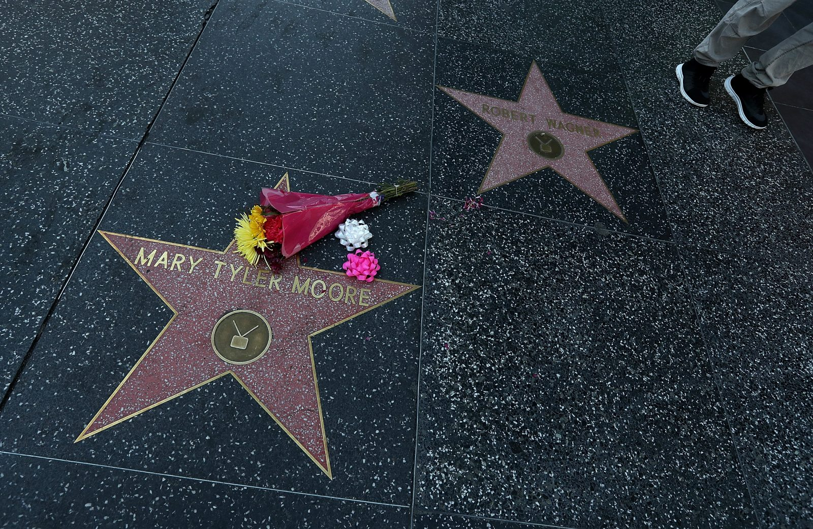 Flowers sit on actress Mary Tyler Moore's Hollywood Walk of Fame star on Wednesday in Hollywooda. Moore died on Wednesday. She was 80 years old. (Justin Sullivan/Getty Images)