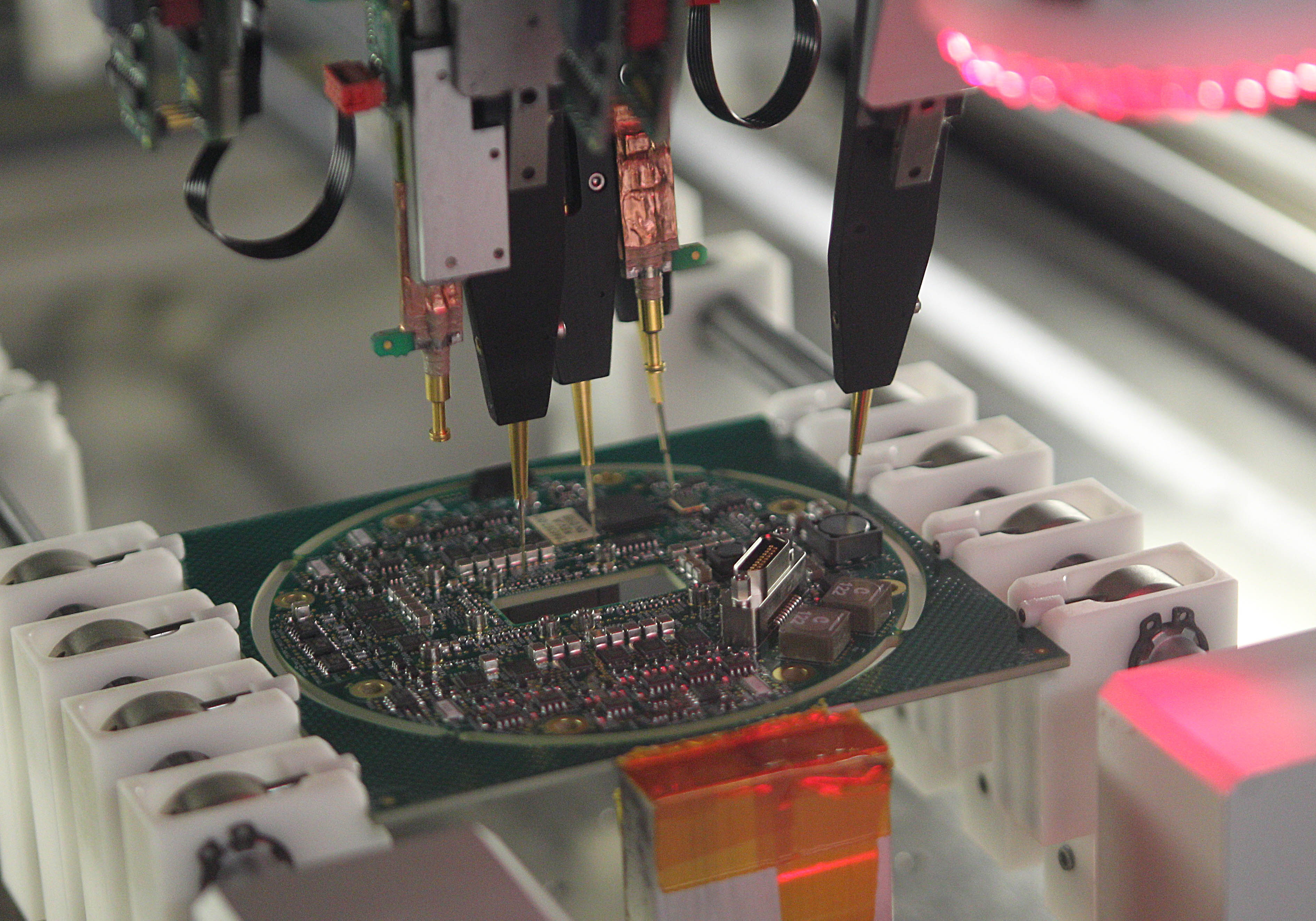 A machine tests a circuit board after it is completed at Moog in October 2012. (Sharon Cantillon / Buffalo News file photo)