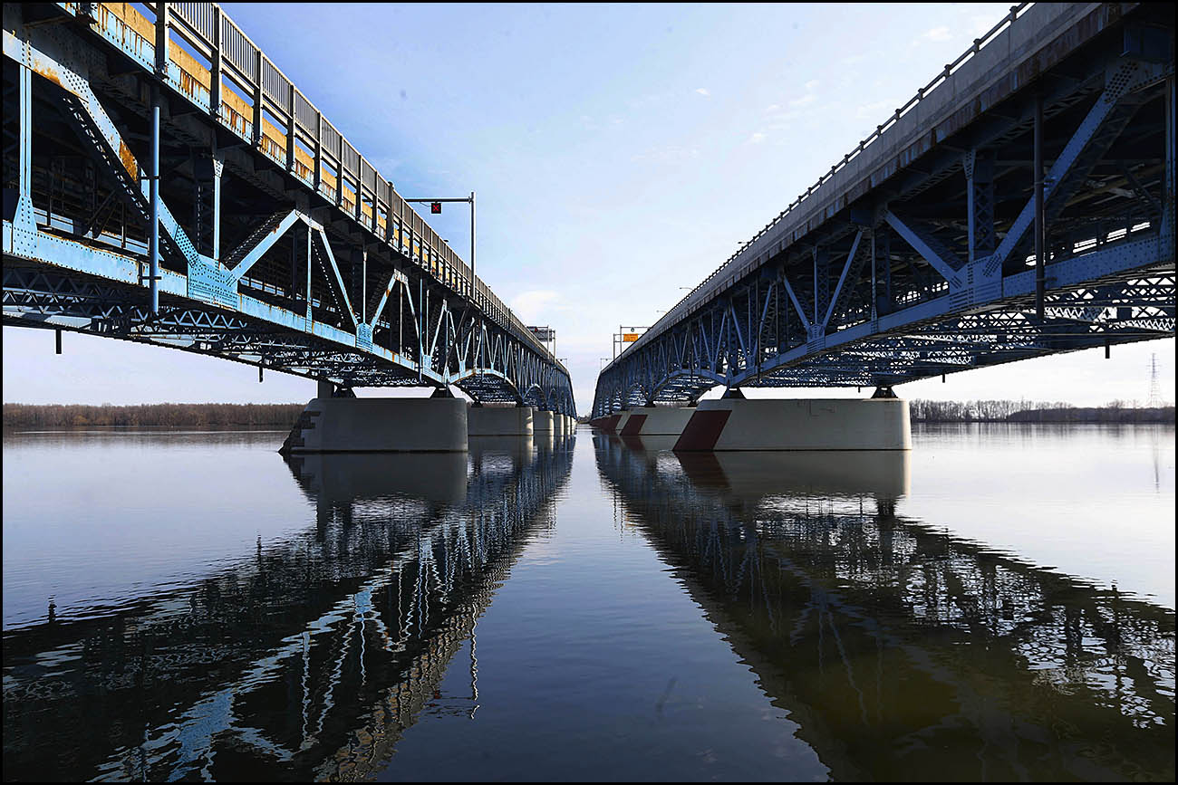 The Grand Island bridges are reflected in the Niagara River on Thursday, April 13, 2017. (Sharon Cantillon/Buffalo News)