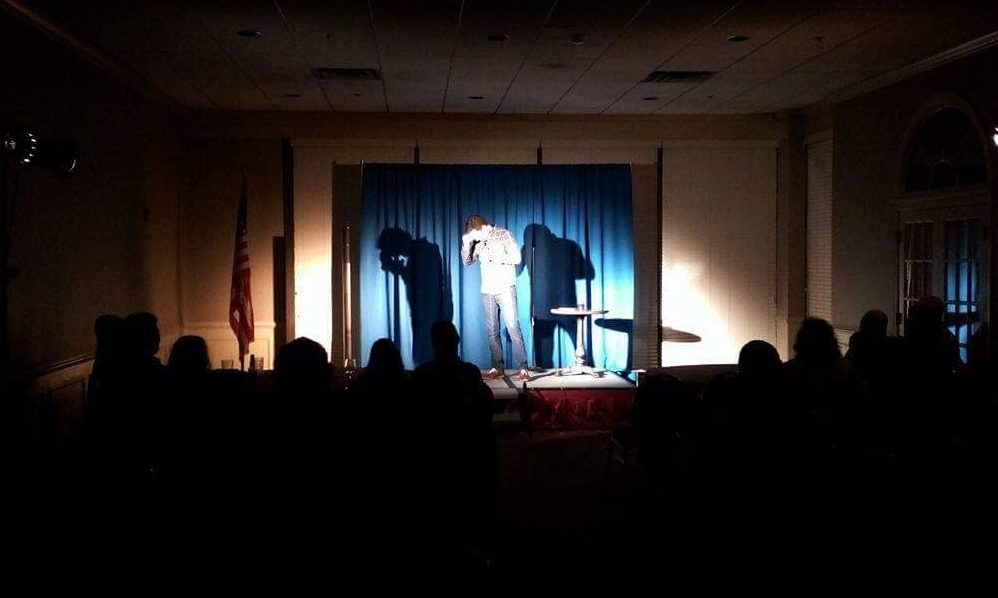 Brian Herberger and his two shadows entertain the crowd in a Virginia hotel.