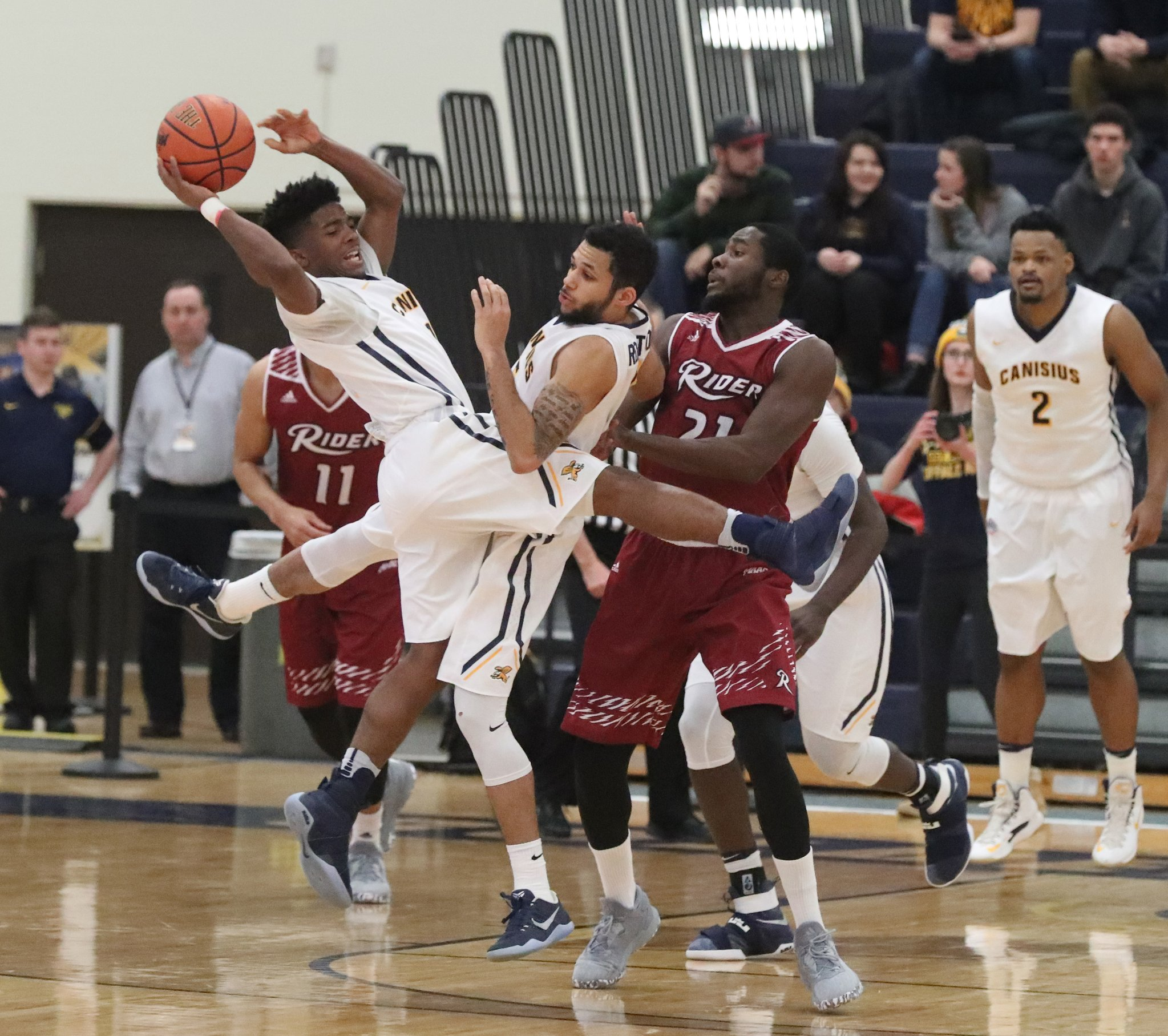 Canisius' Malik Johnson makes a pass. (James P. McCoy/Buffalo News)