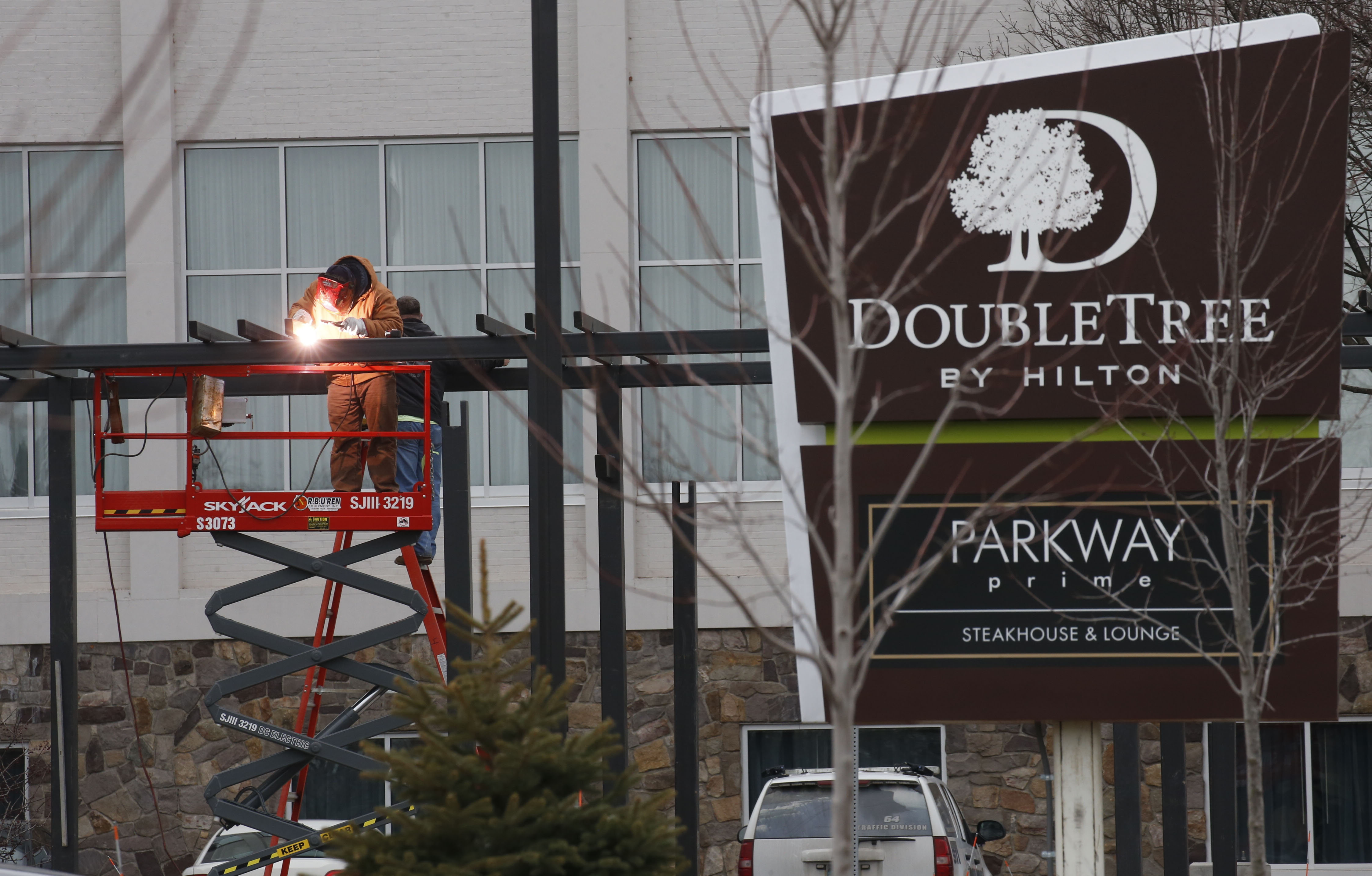 A worker puts some finishing touches on the new Double Tree Hotel in Niagara Falls.  (Robert Kirkham/Buffalo News)