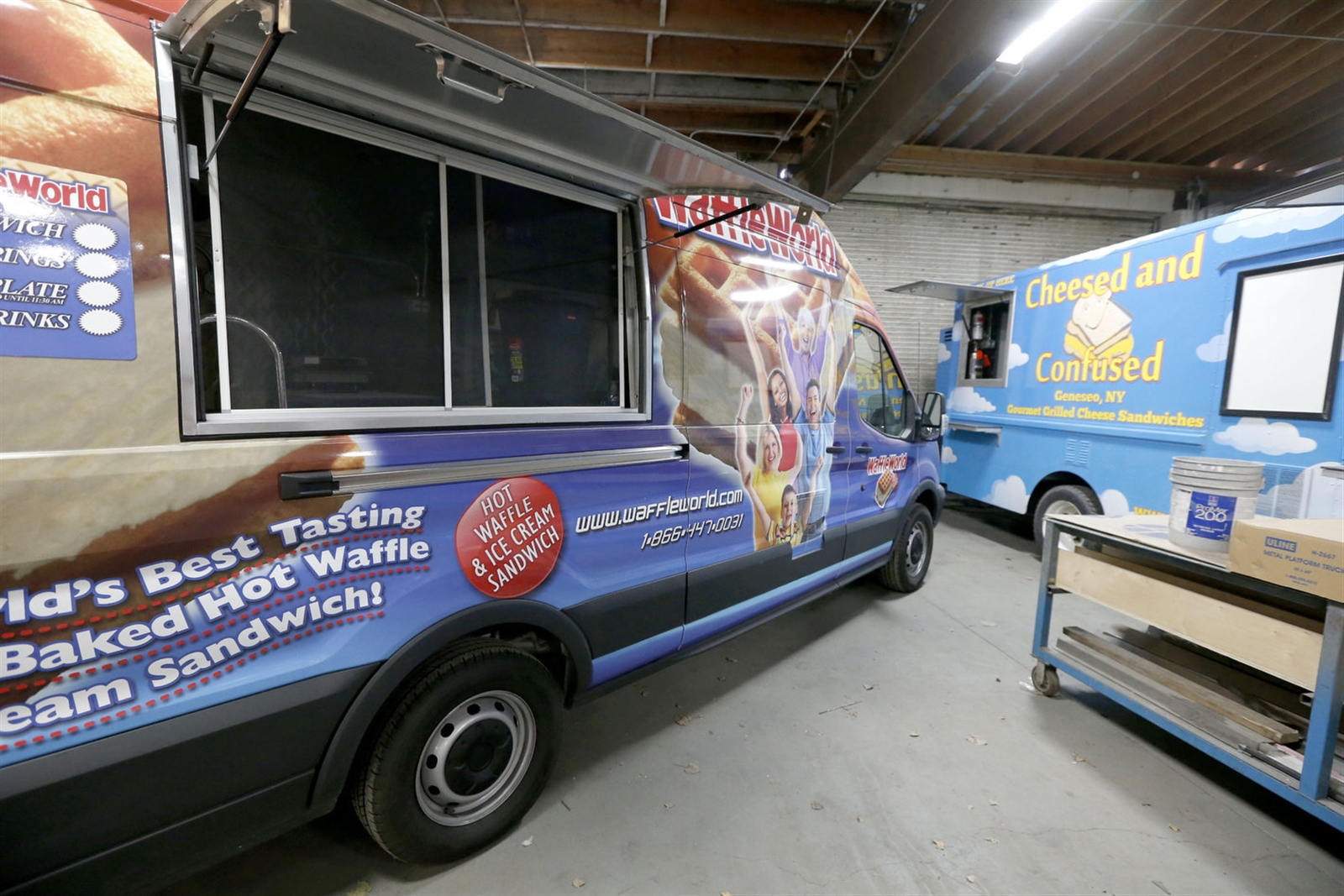 Food trucks parked inside the Buffalo OutFront Metalworks facility wait for their makeover. (Robert Kirkham/Buffalo News)
