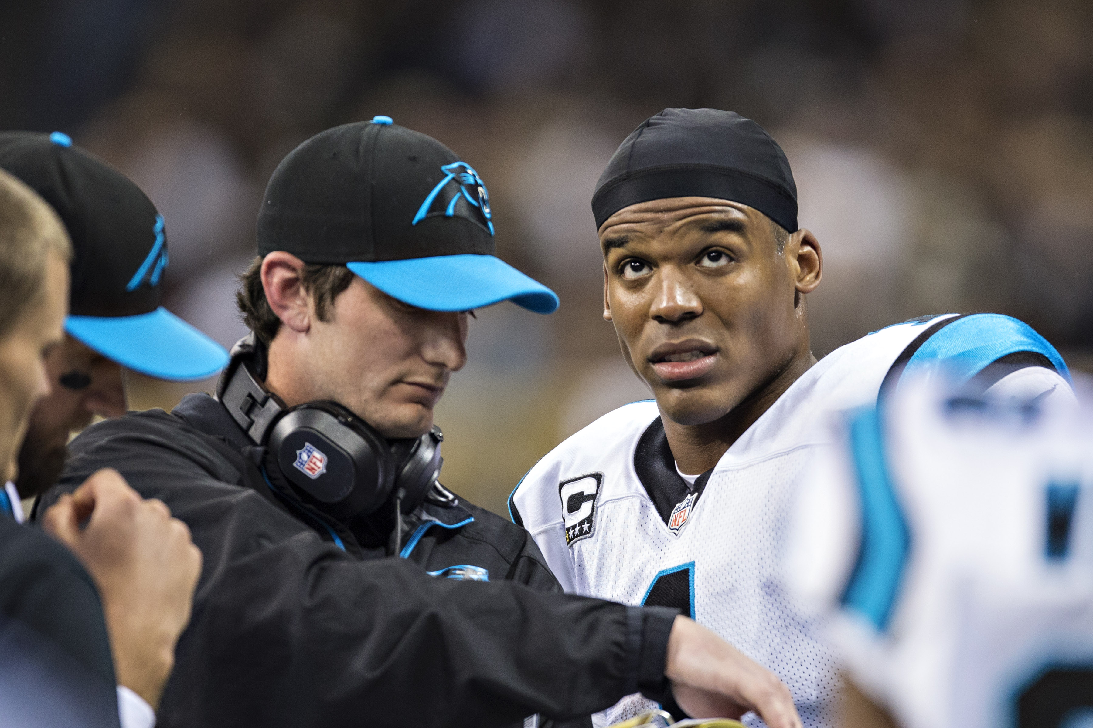 Ken Dorsey, quarterbacks coach of the Carolina Panthers, confers with Cam Newton during a 2013 game. (Getty Images)