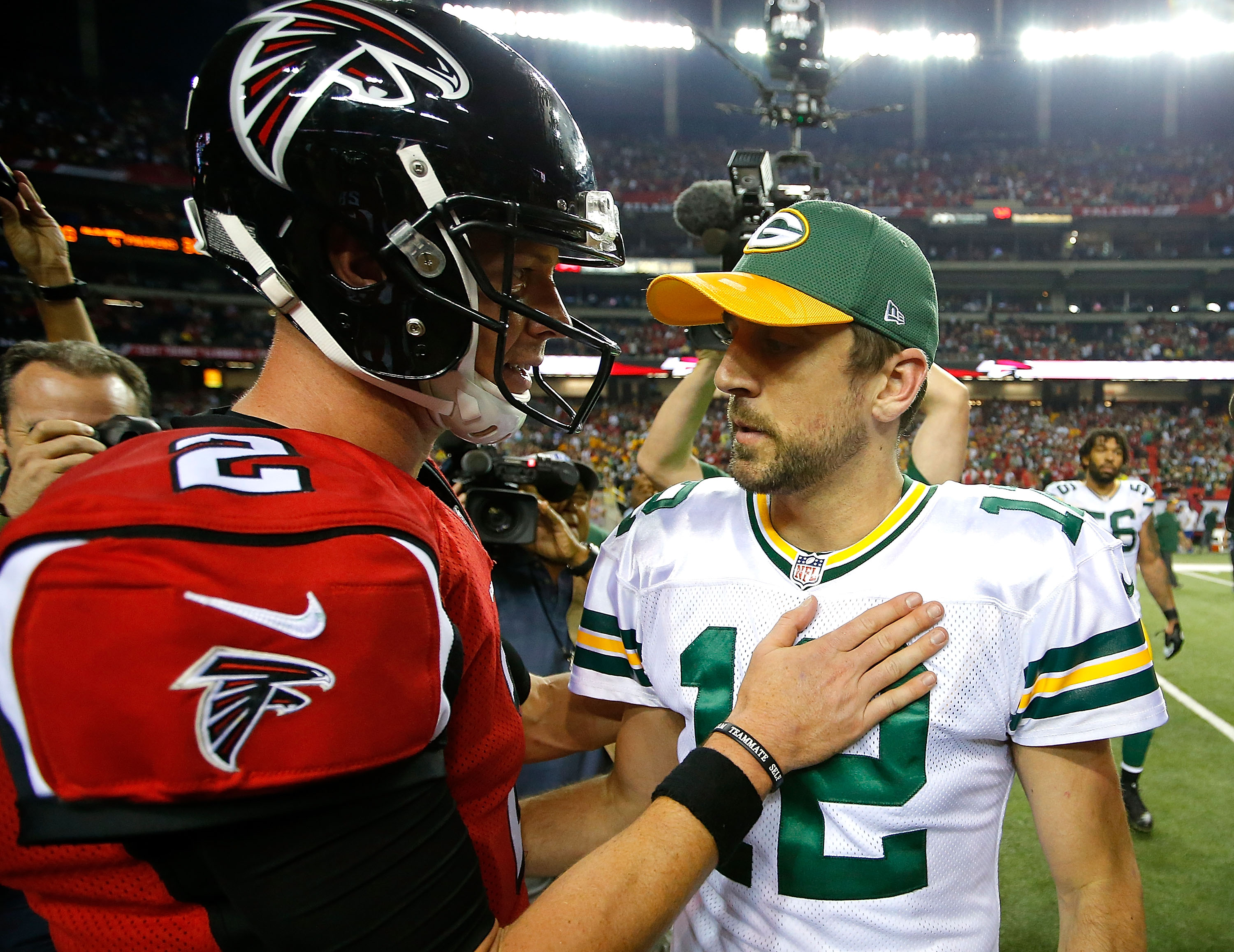 Matt Ryan of the Atlanta Falcons (left) converses with Aaron Rodgers of the Green Bay Packers after Atlanta's 33-32 win at Georgia Dome on October 30, 2016; the QBs will meet again in this week's NFC Championship. (Getty Images)