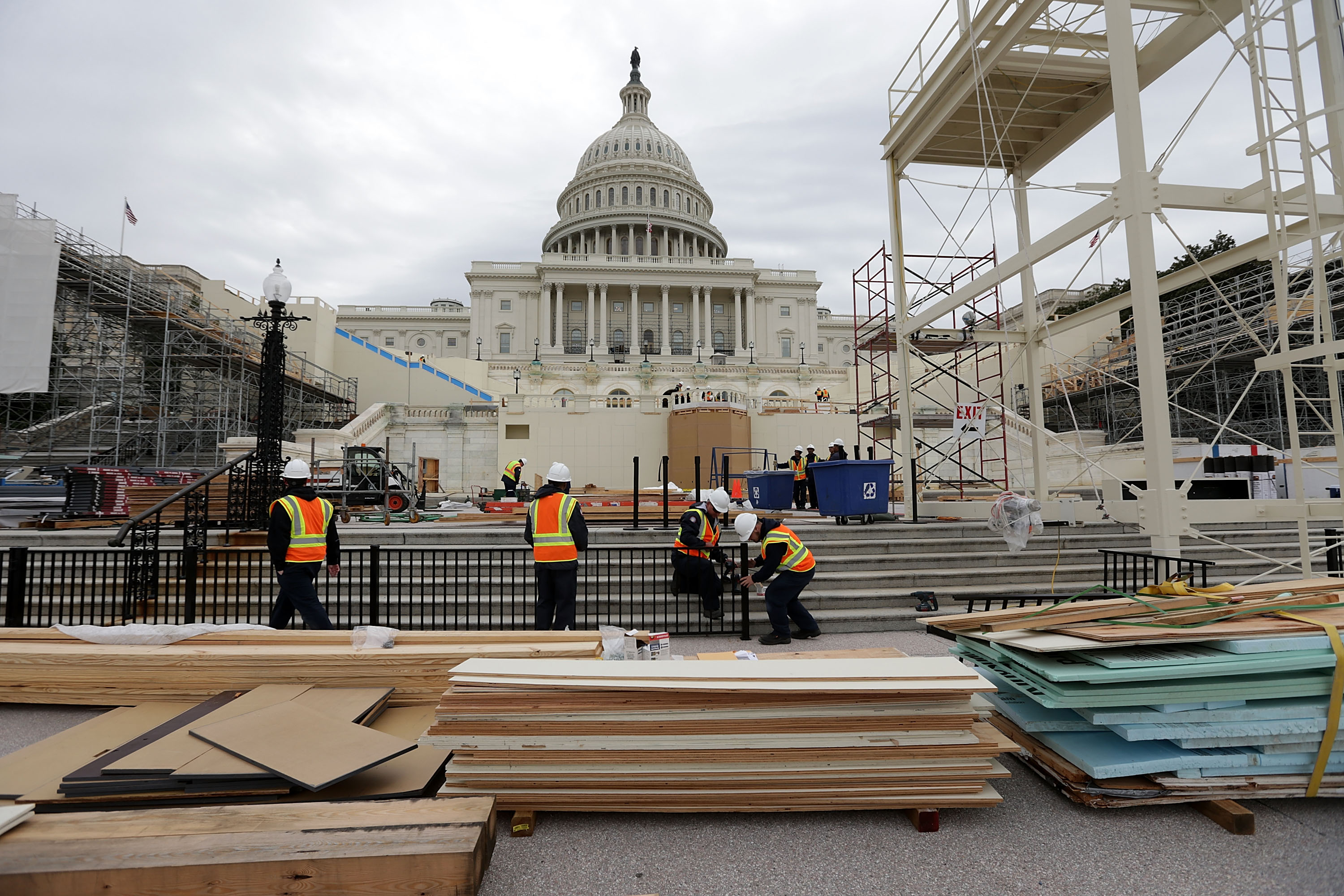 Employees of the Architect of the Capitol put up a fence at the West Front of the Capitol as construction of the 2017 presidential inaugural platform continues December 8, 2016 on Capitol Hill in Washington, DC. The inaugural platform will be used for swearing in the nation's 45th president Donald Trump on January 20, 2017.  (Getty Images)