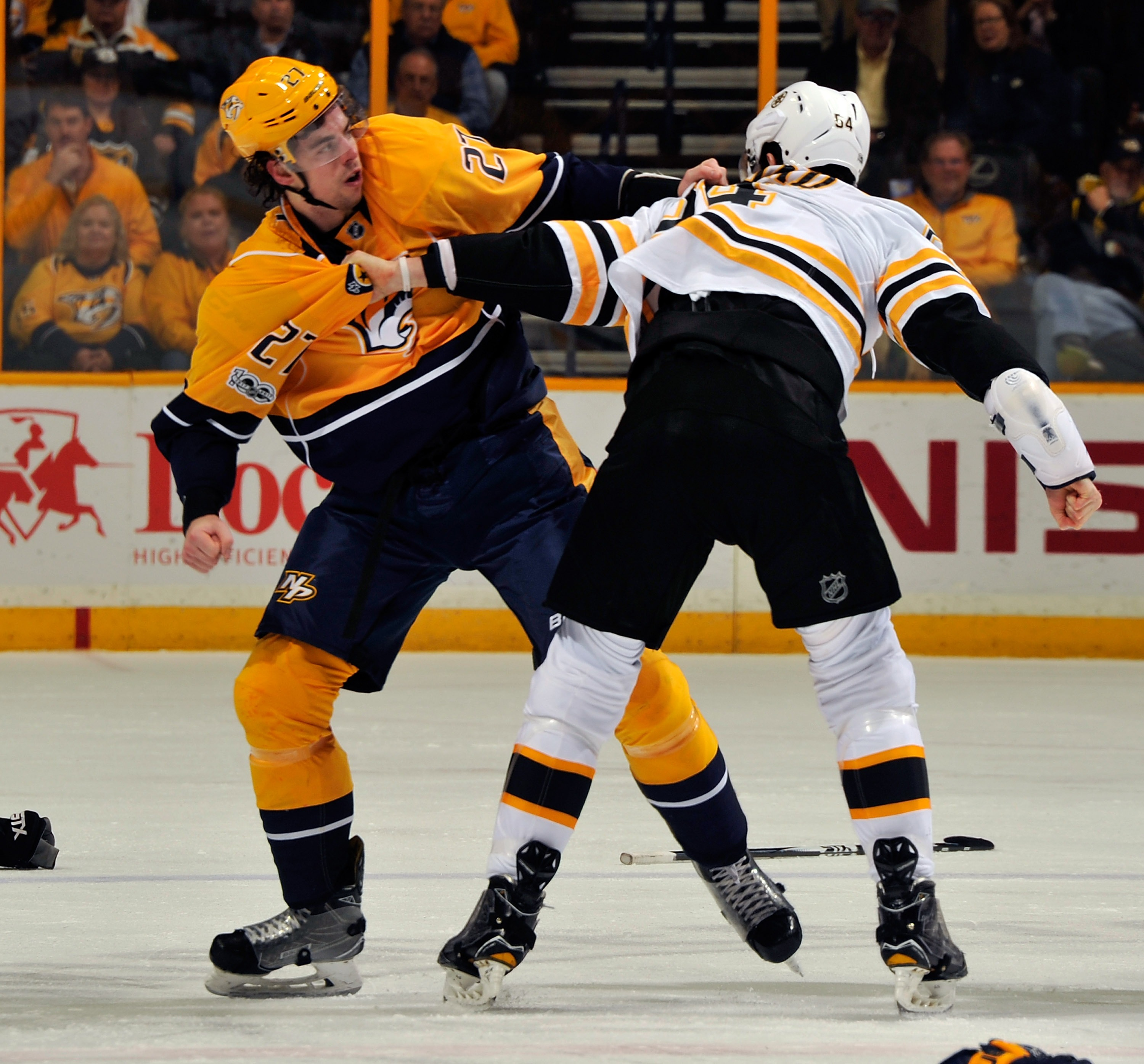Derek Grant, left, fought Boston's Adam McQuaid during his first game with Nashville. (Getty Images)