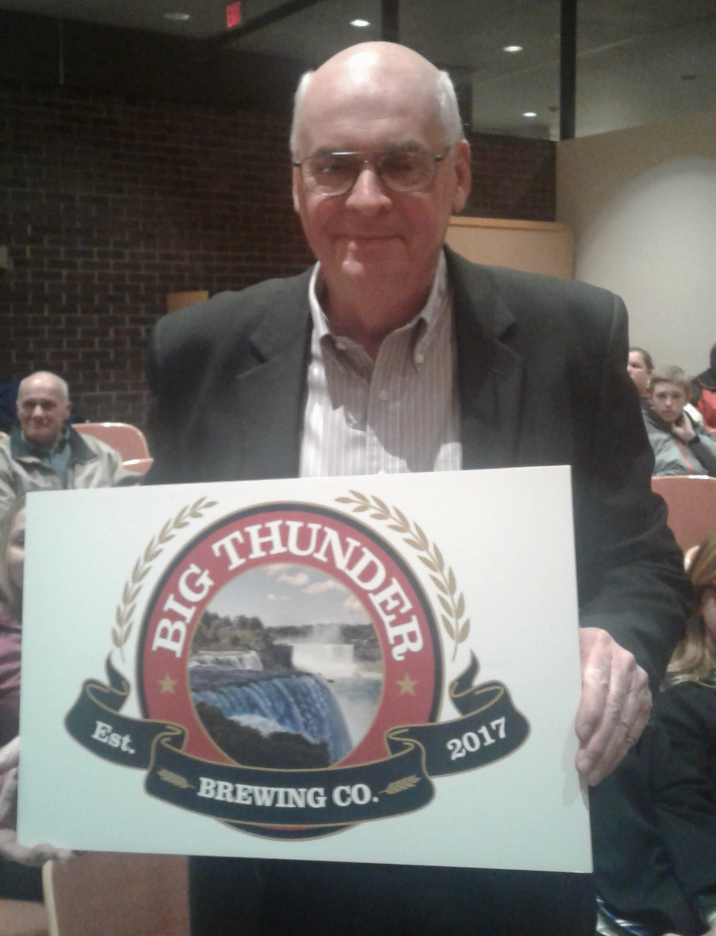 John Robinson, principal in Big Thunder Brewing Co., displays the company logo at Wheatfield Town Hall Jan. 23, 2017. (Thomas J. Prohaska / Buffalo News)