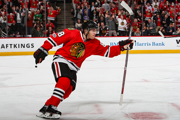 Patrick Kane gets the celebration cranked up after beating the Sabres with an overtime goal Thursday night (Getty Images).