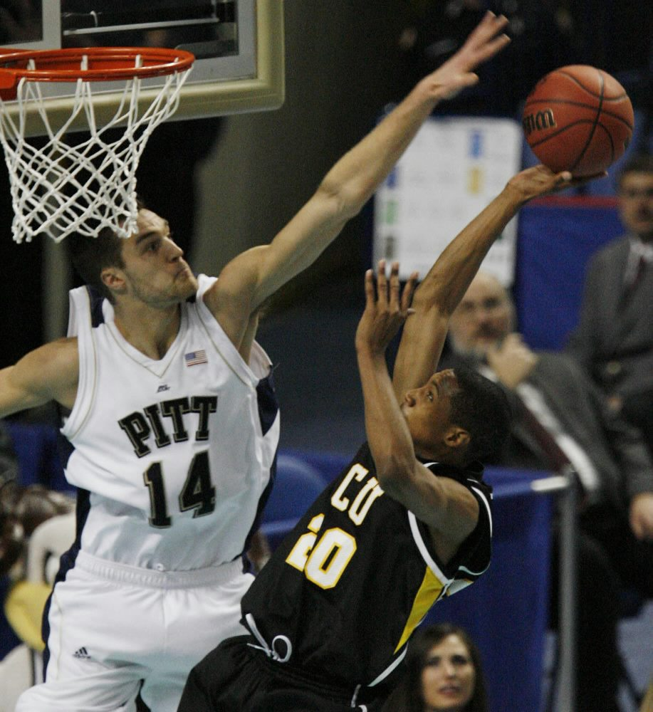Pittsburgh's Levon Kendall  tries to block VCU's B.A. Walker during the second half. (Mark Mulville/Buffalo News)