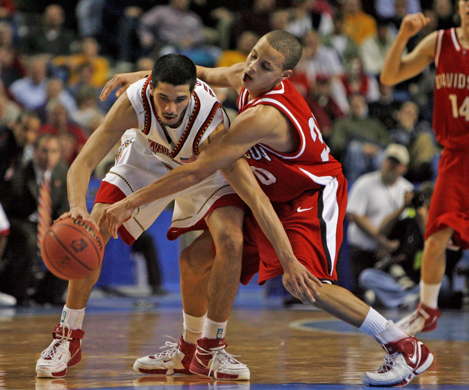 Maryland   Greivis Vasquez  keeps the ball away from  Davidson's Steph Curry. (James P. McCoy/Buffalo News)