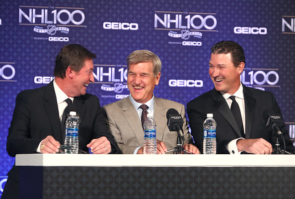 Wayne Gretzky, Bobby Orr and Mario Lemieux share a laugh Friday in Los Angeles (Getty Images).