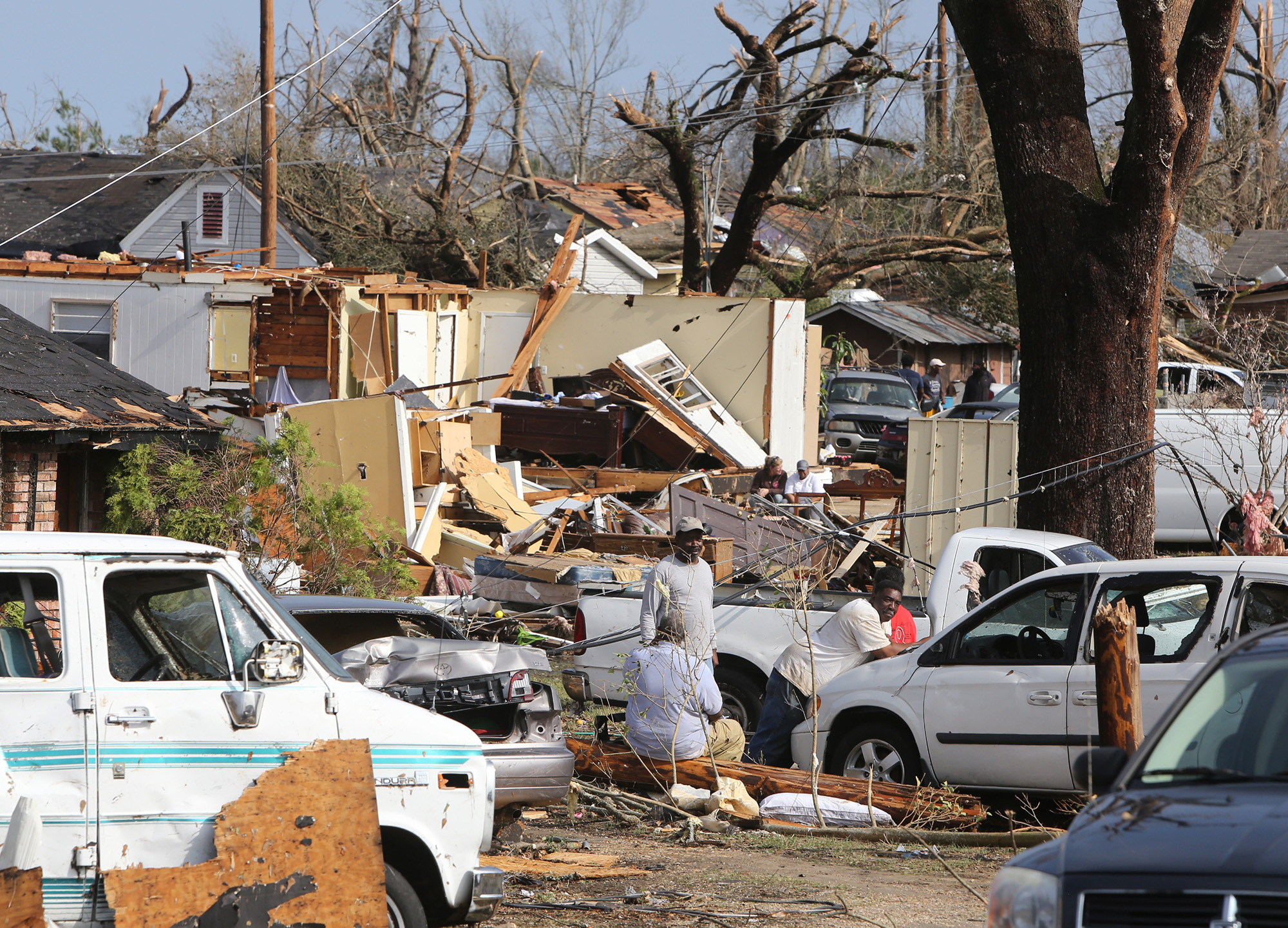 Residents of Magnolia Street in Hattiesburg, Miss., take a break from cleaning up after a tornado hit the area on Saturday, Jan. 21, 2017. Four people died and at least 25 were injured in the storm. (John Fitzhugh/Biloxi Sun Herald/TNS)
