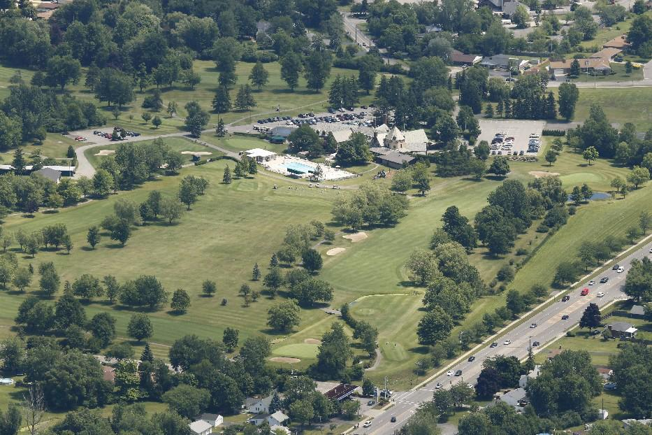 An aerial view of the former Westwood Country Club. The town, developer Mensch Capital Partners and neighbors are close to reaching common ground on the long-stalled reuse of the site as part of a planned Amherst Central Park. (Derek Gee/News file photo)
