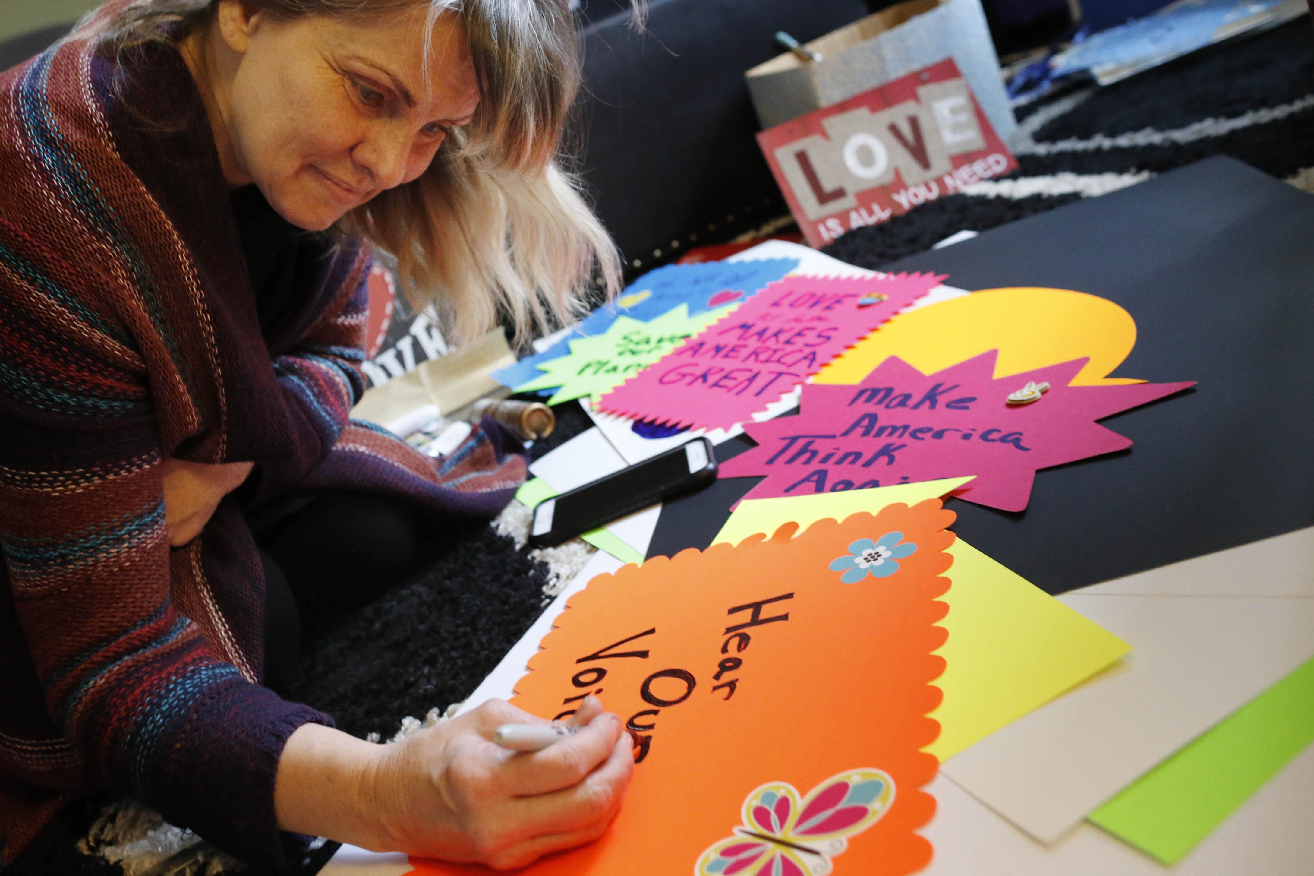 Lisa Jo Schaeffer makes signs while preparing for the Women's March on Washington on Saturday, Jan.  21, 2017. Schaeffer has organized a bus to carry protesters from Buffalo to Washington, D.C., to attend. She was making signs for the demonstration on  Tuesday, Jan. 17, 2017.  (Derek Gee/Buffalo News)