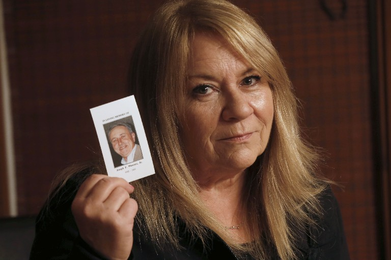 Linda Muscato doesn't want revenge, just answers, about the 2001 arson at Rosa's that killed her husband, Joe (Robert Kirkham/Buffalo News)