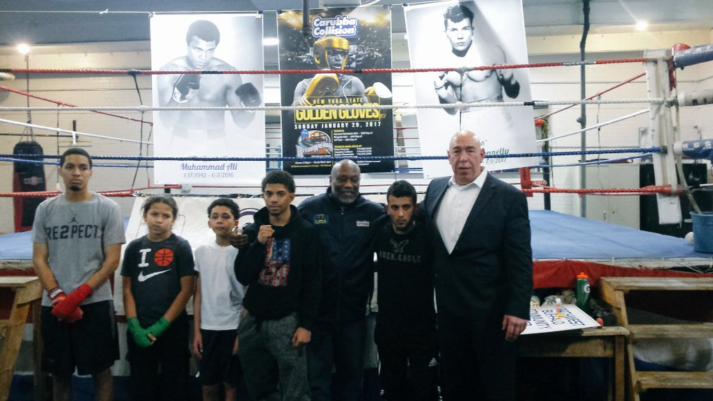 Don Patterson, center, and Joe Carubba, right, pose with boxers during the press conference for the upcoming New York State Golden Gloves Tournament, which begins Sunday.