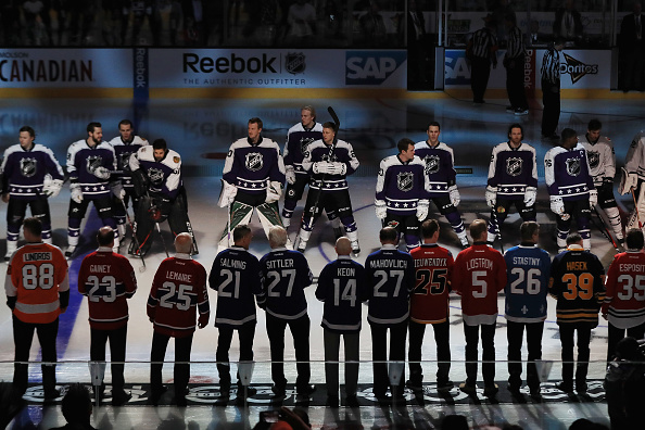 Members of the NHL100 and current players take part in Sunday's pregame ceremony prior to the All-Star Game in Los Angeles (Getty Images).