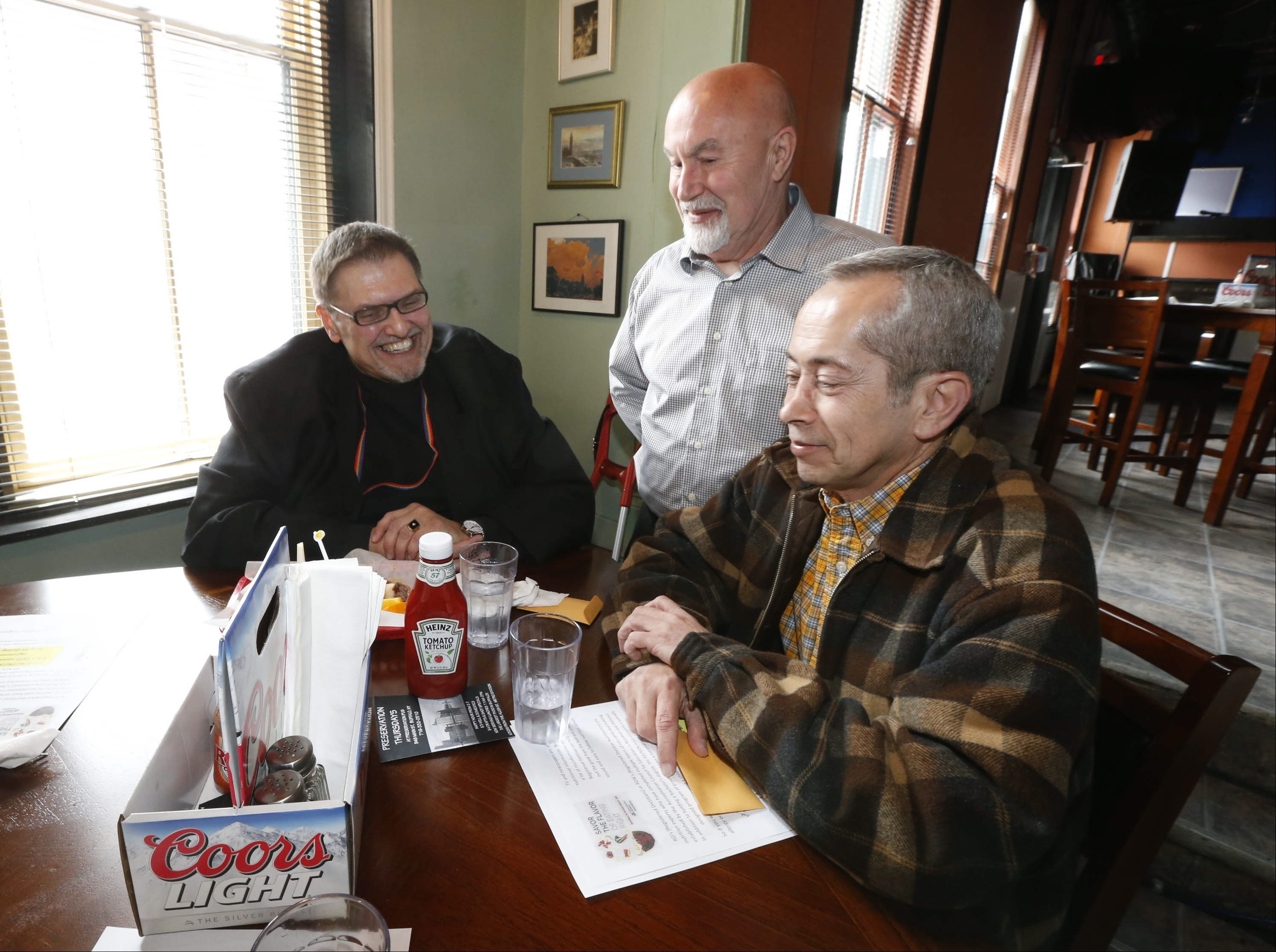 Erie County Department of Senior Services hosts a monthly senior lunch program at Preservation Pub on Main Street. (Robert Kirkham/Buffalo News file photo)