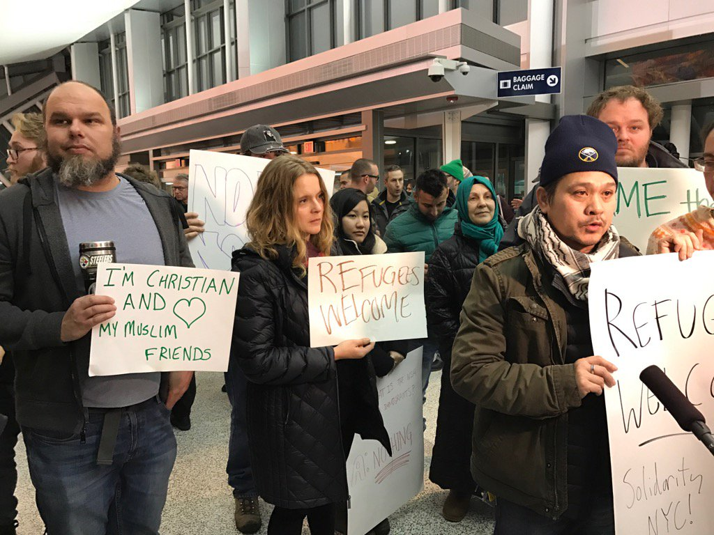 About 150 protesters gathered at the Buffalo Niagara International Airport to demonstrate Saturday night against President Trump's immigration order. (Matt Gryta/Buffalo News)