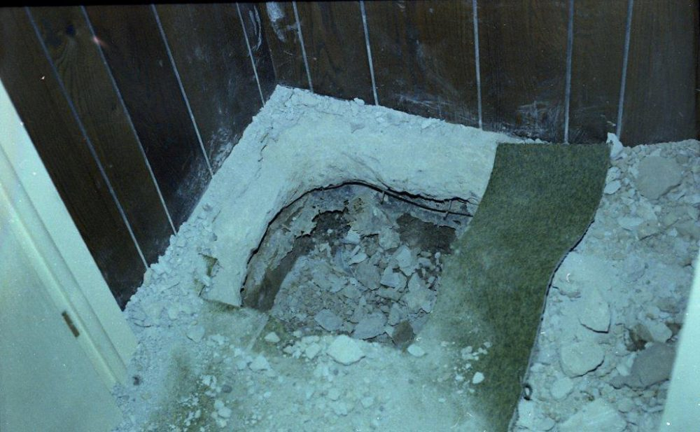 The hole in the floor at the Ski Wing resort where the killers stole a safe containing $18,000. (Photo from State Police)