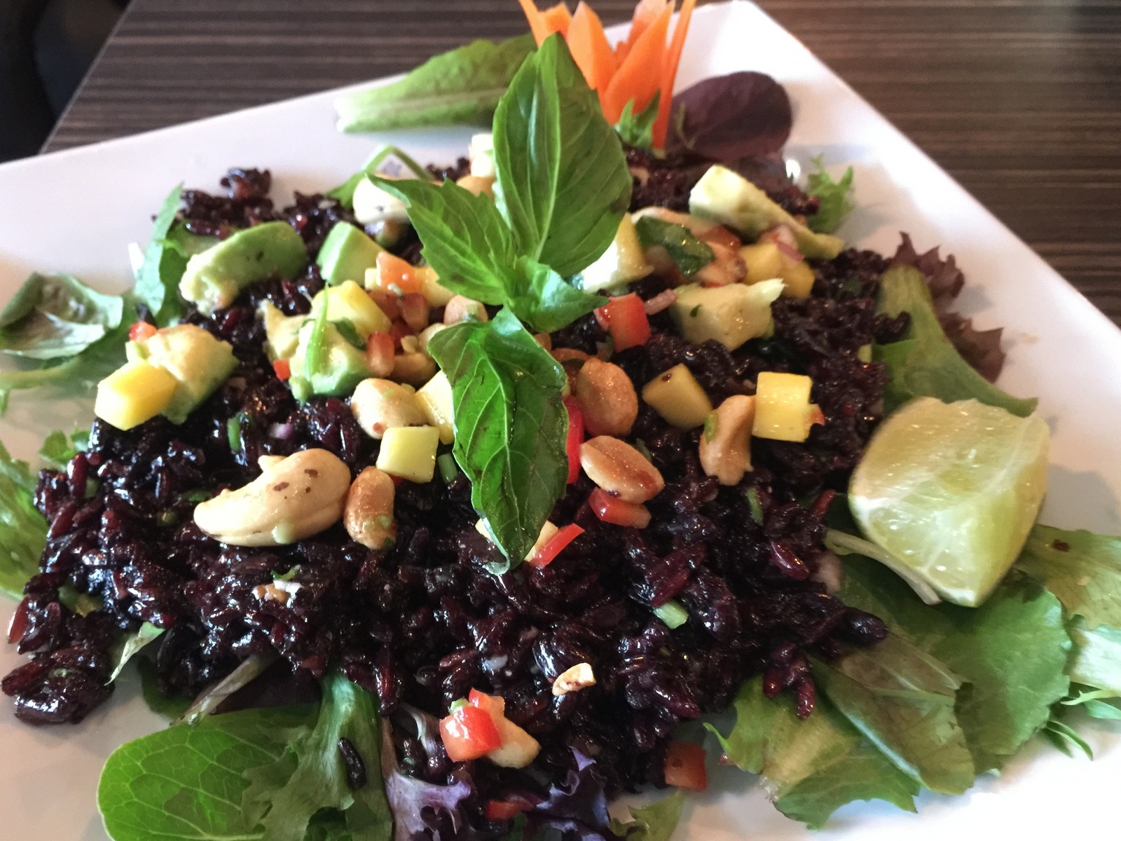 Black rice salad with avocado, mango and cashews at Sun Williamsville. (Andrew Galarneau/Buffalo News)