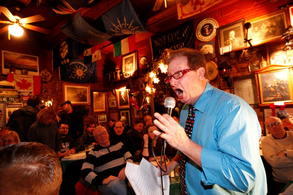 Mike Driscoll, the owner of Founding Fathers Pub, asks questions at Trivia Night. Driscoll says he avoids talking politics with patrons. (Sharon Cantillon/Buffalo News)